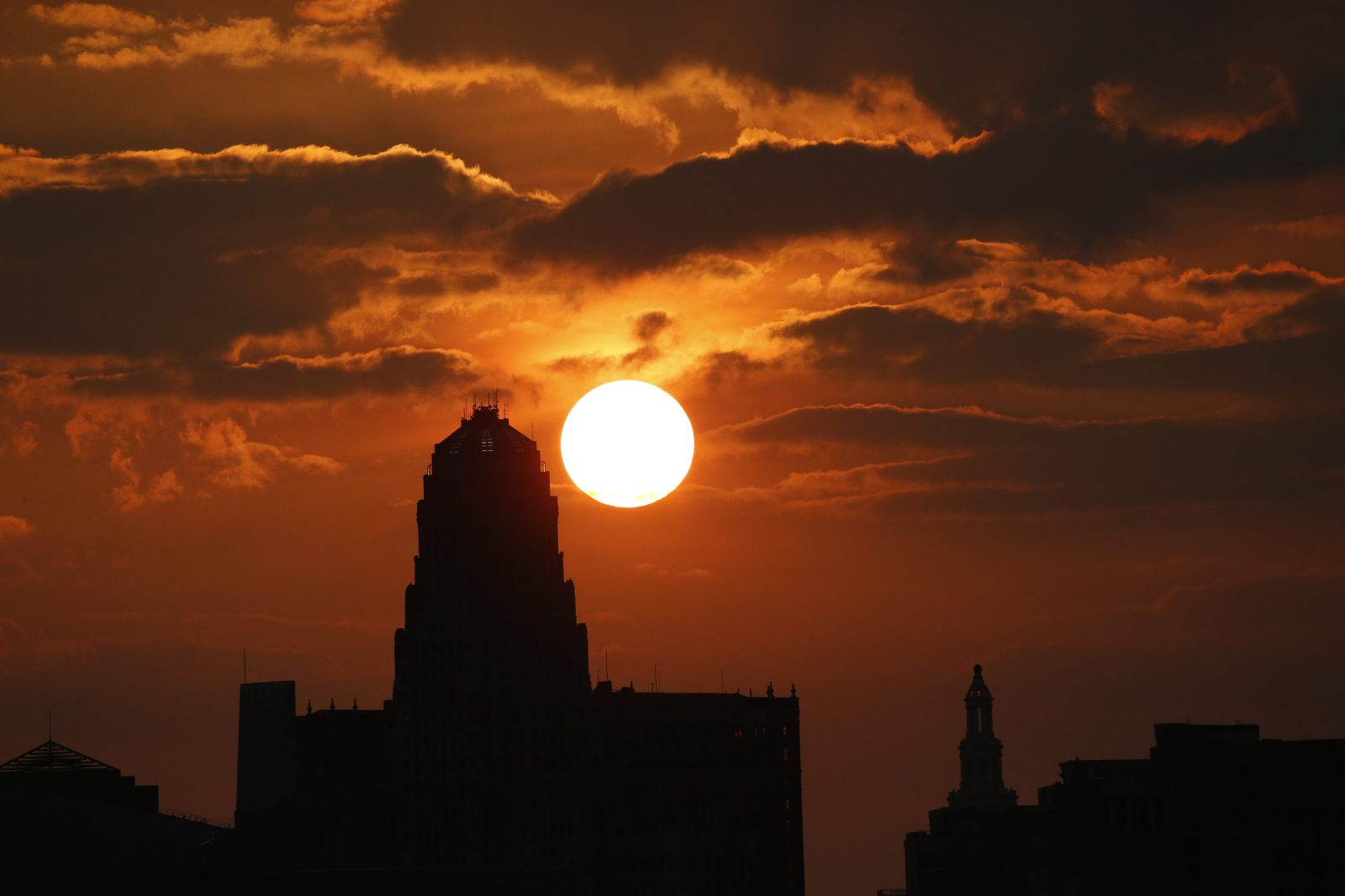 The sun rises behind the City of Buffalo, N.Y., Wednesday, July 6, 2016.  (Photo by Derek Gee)