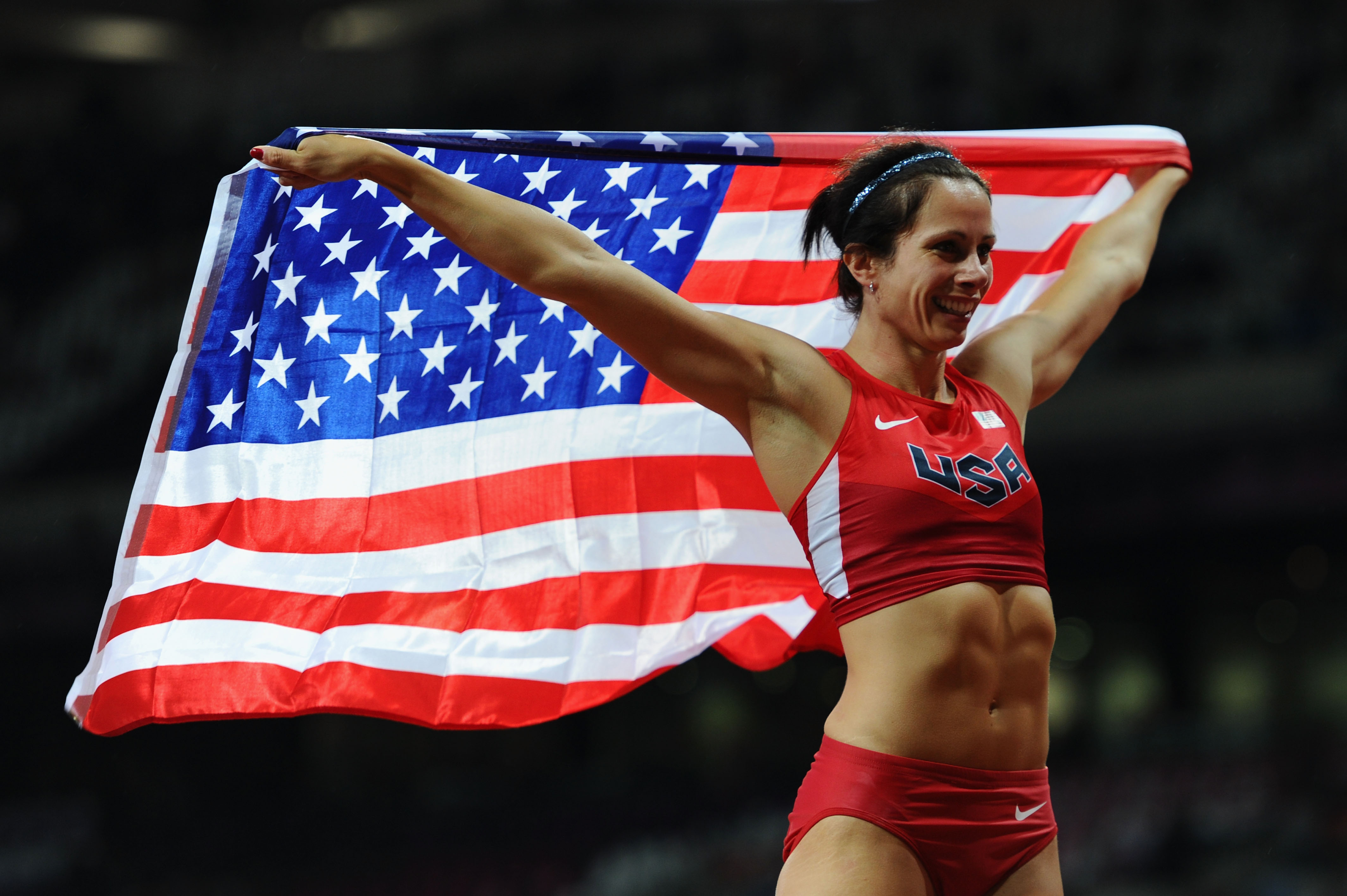 Jenn Suhr celebrates after winning the gold medal at the London 2012 Olympics. (Getty Images)