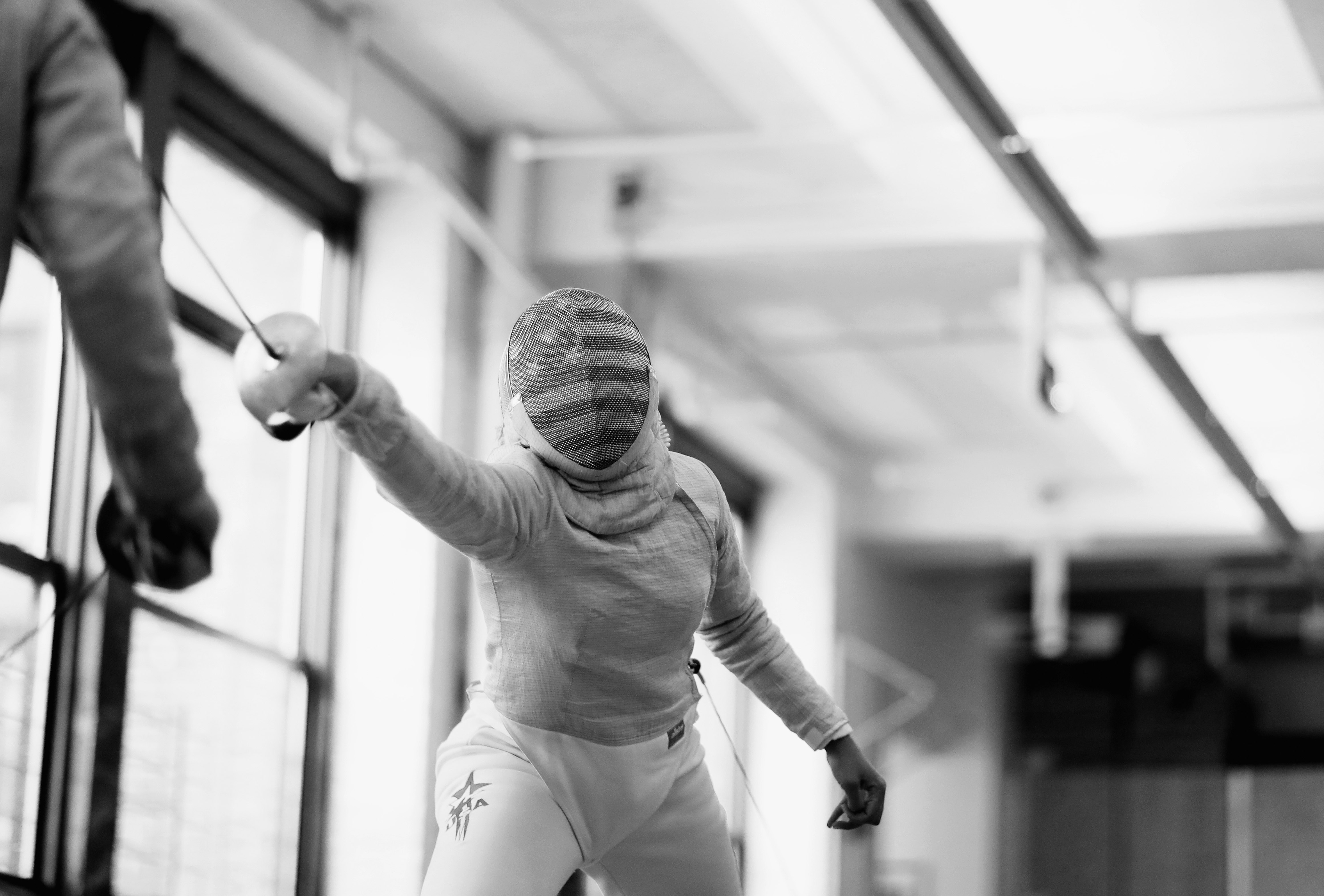 NEW YORK, NY - JULY 07: American Olympic fencer Ibtihaj Muhammad (right) practices with Liam Cotter during a training session at the Fencers Club on July 7, 2016 in New York City. Muhammad will be the first Muslim women to represent the United States while wearing a hijab at the 2016 Rio Olympic Games. (Photo by Ezra Shaw/Getty Images)