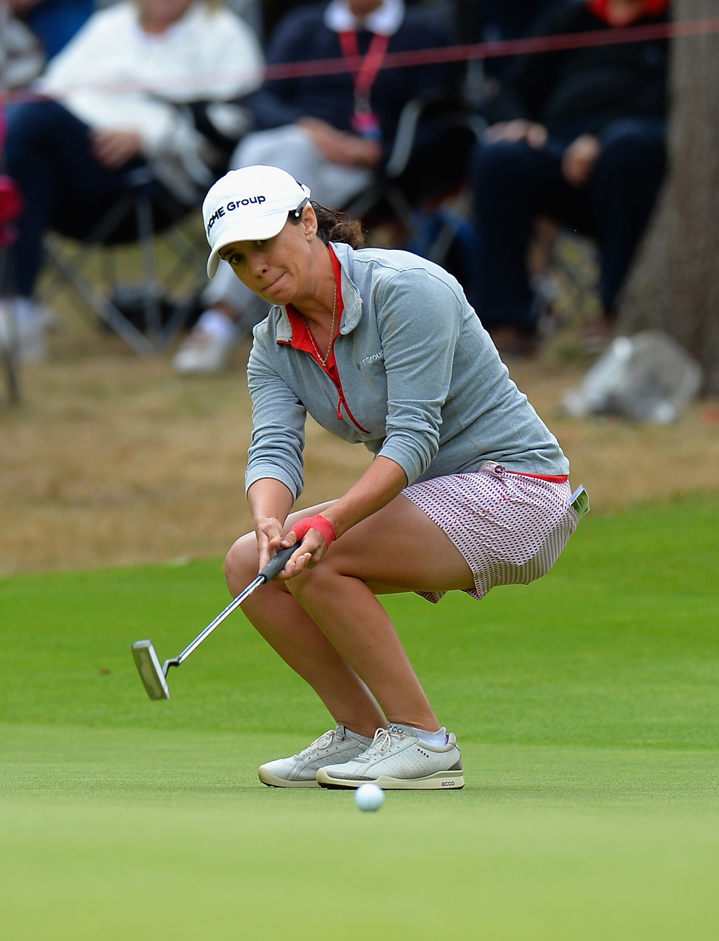 WOBURN, ENGLAND - JULY 31: Mo Martin of USA reacts as she misses a birdie chance on the 17th green during the Ricoh Women's British Open - Day Four at Woburn Golf Club on July 31, 2016 in Woburn, England. (Photo by Tony Marshall/Getty Images)