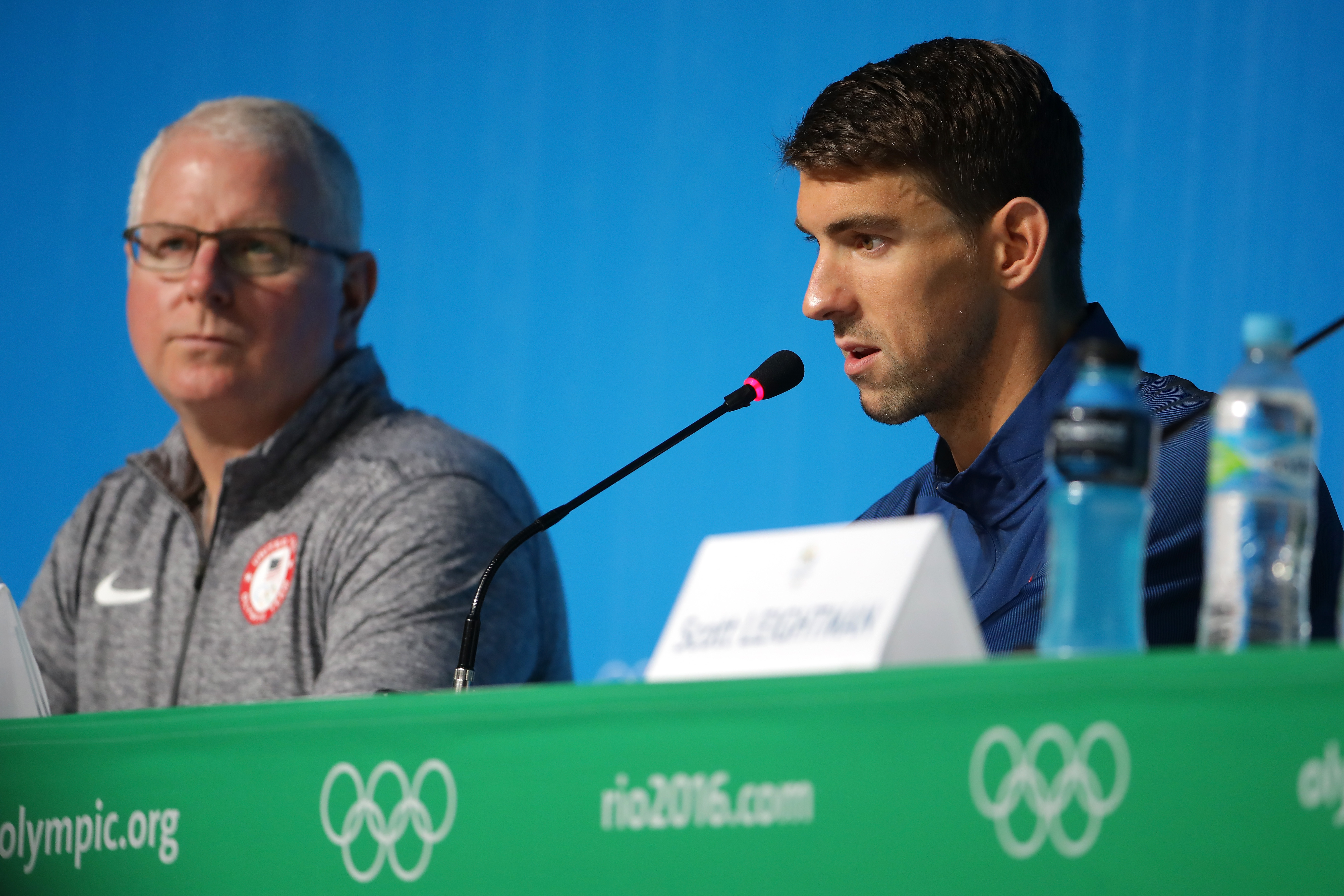 RIO DE JANEIRO, BRAZIL - AUGUST 03: Bob Bowman and Michael Phelps of the United States speak with the media during a press conference at the Main Press Centre ahead of the Rio 2016 Olympic Games on August 3, 2016 in Rio de Janeiro, Brazil. (Photo by Chris Graythen/Getty Images)