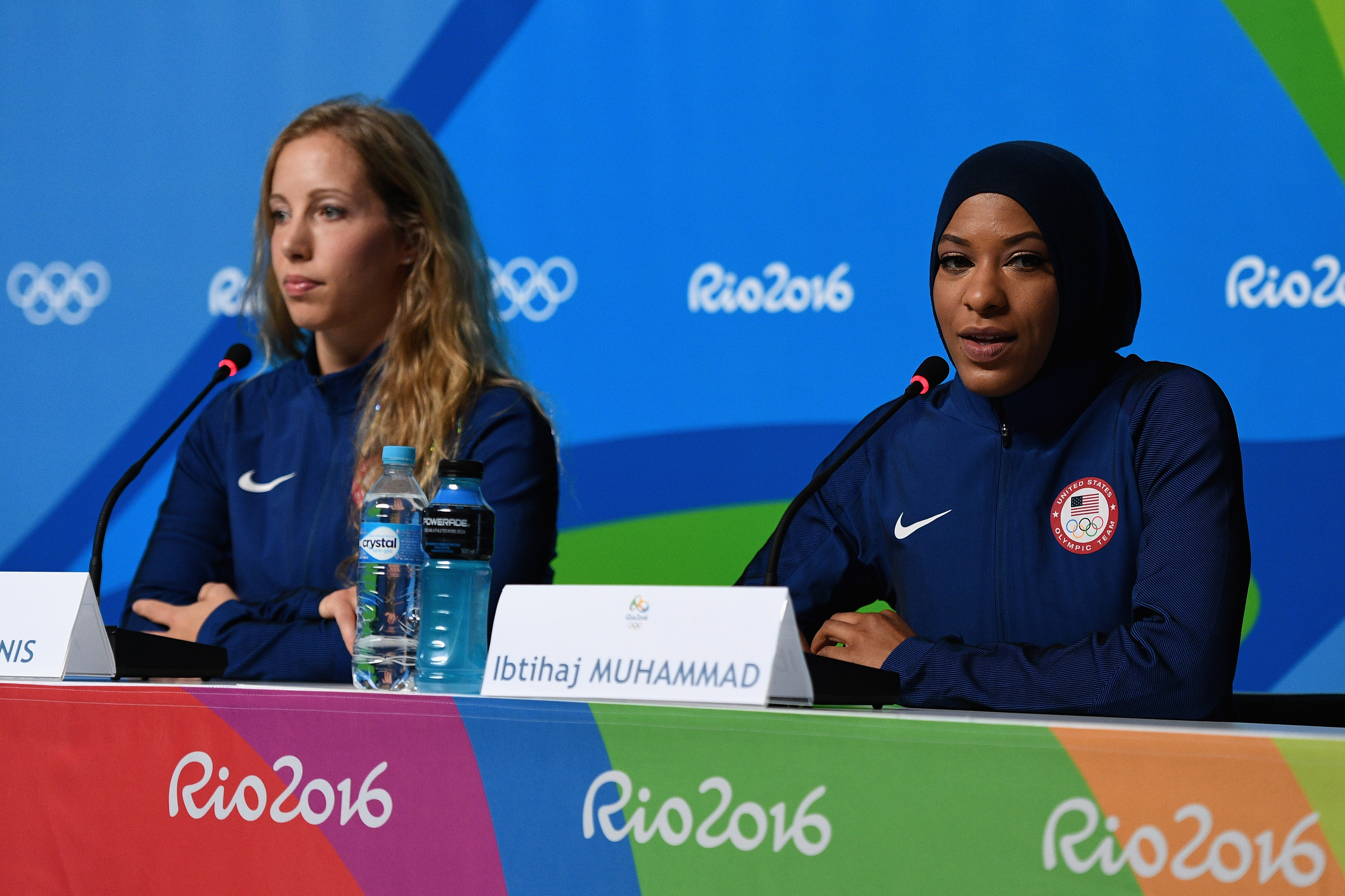 RIO DE JANEIRO, BRAZIL - AUGUST 04: (L-R) American Olympic fencers Mariel Zagunis and Ibtihaj Muhammad face the media during a press conference on August 4, 2016 in Rio de Janeiro, Brazil. (Photo by David Ramos/Getty Images)