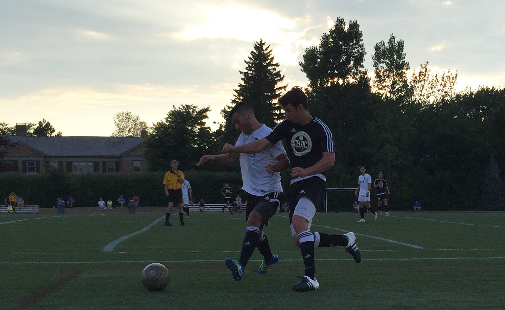 Francesco Strangio, in white, battles for a loose ball with Celtic United's Luke Loecher. (Ben Tsujimoto/Buffalo News)