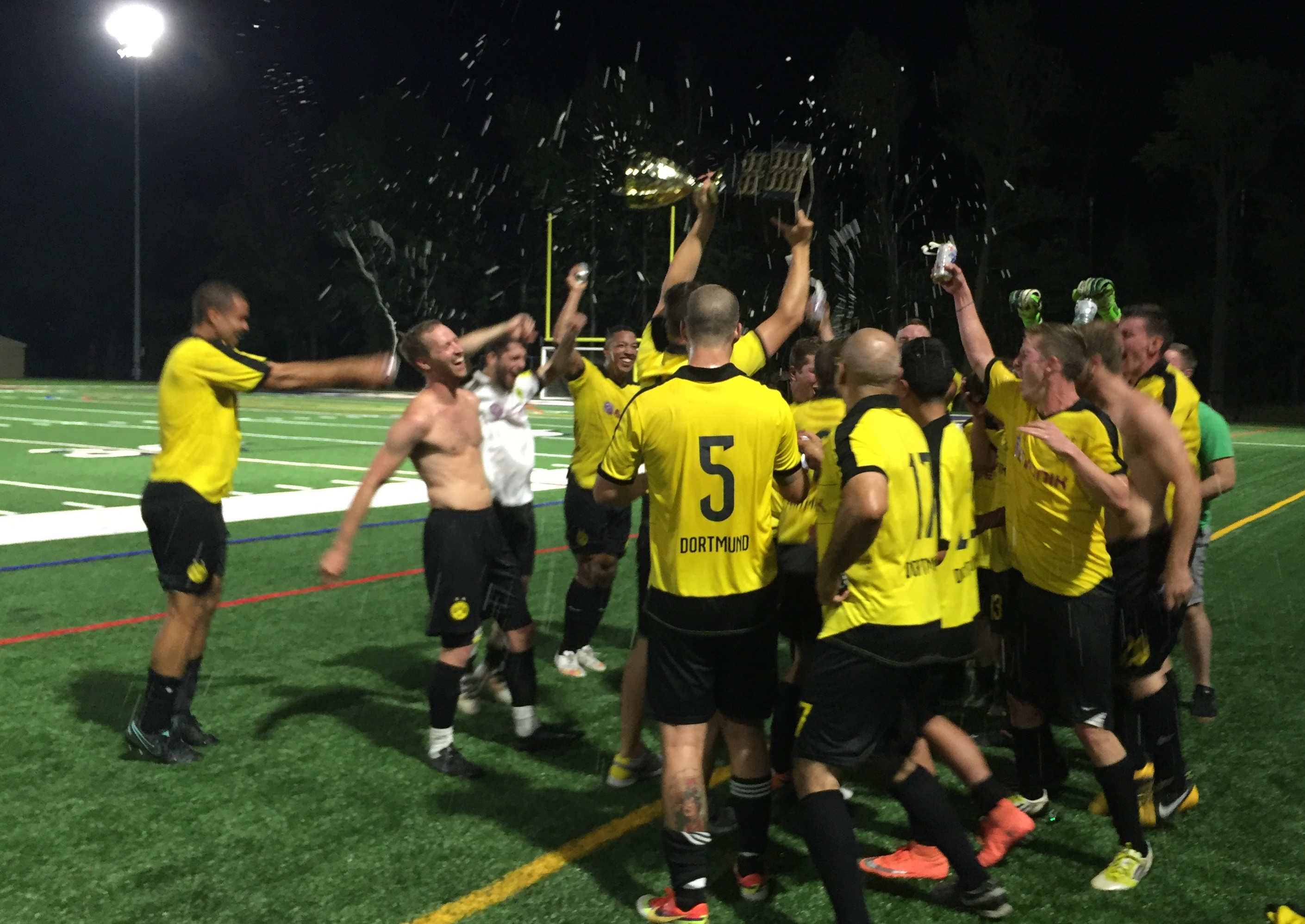 Clarence celebrate their 2016 Tehel Cup win. (Ben Tsujimoto/Buffalo News)