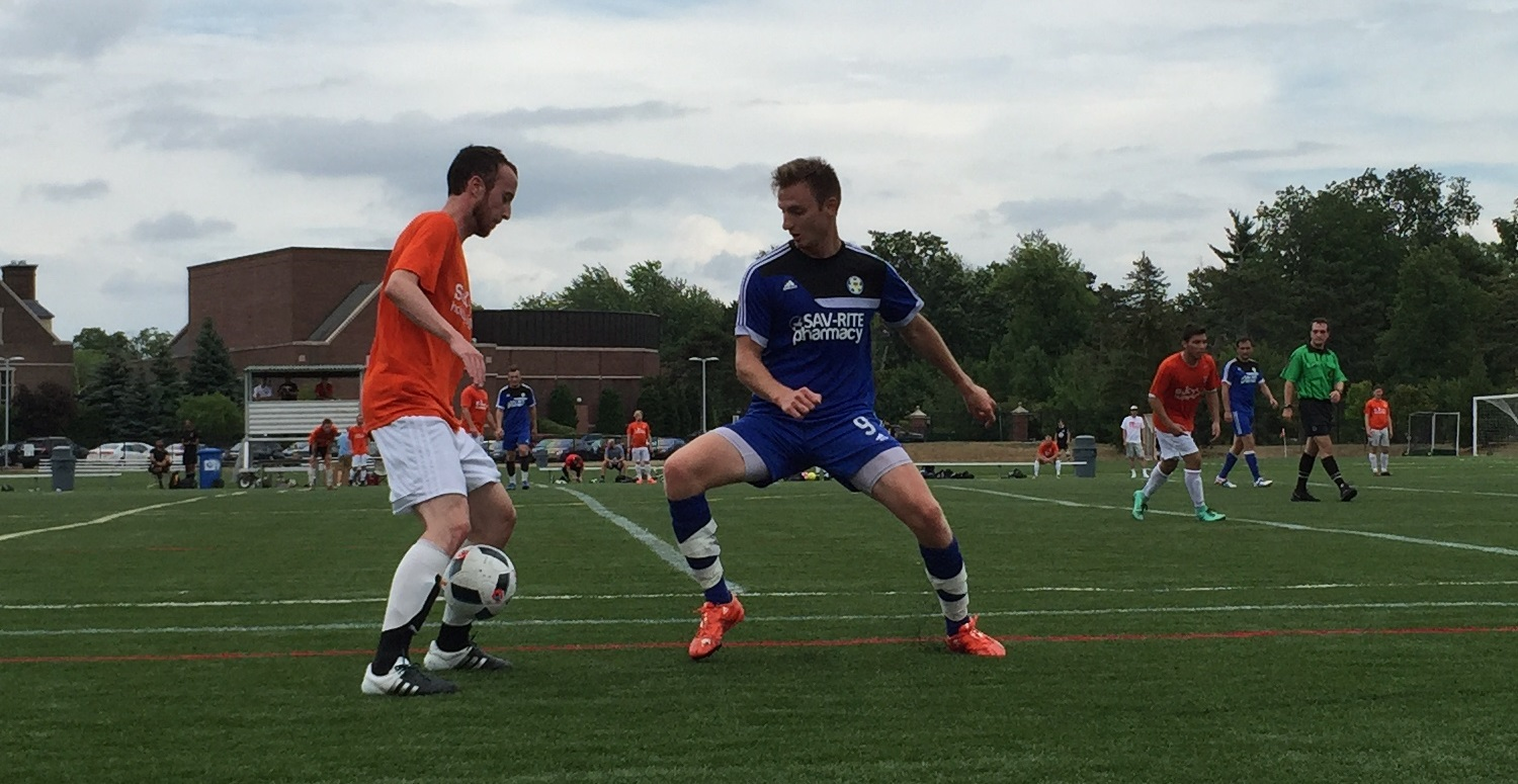Smajil Mulahmetovic, in blue, defends Dutch FC's Chris Waclawski. (Ben Tsujimoto/Buffalo News)