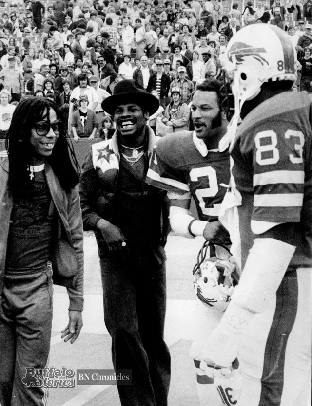 Rick James and former heavyweight champ Leon Spinks chat with a couple of Buffalo Bills on the Rich Stadium sidelines, 1979. (Buffalo News archives.)