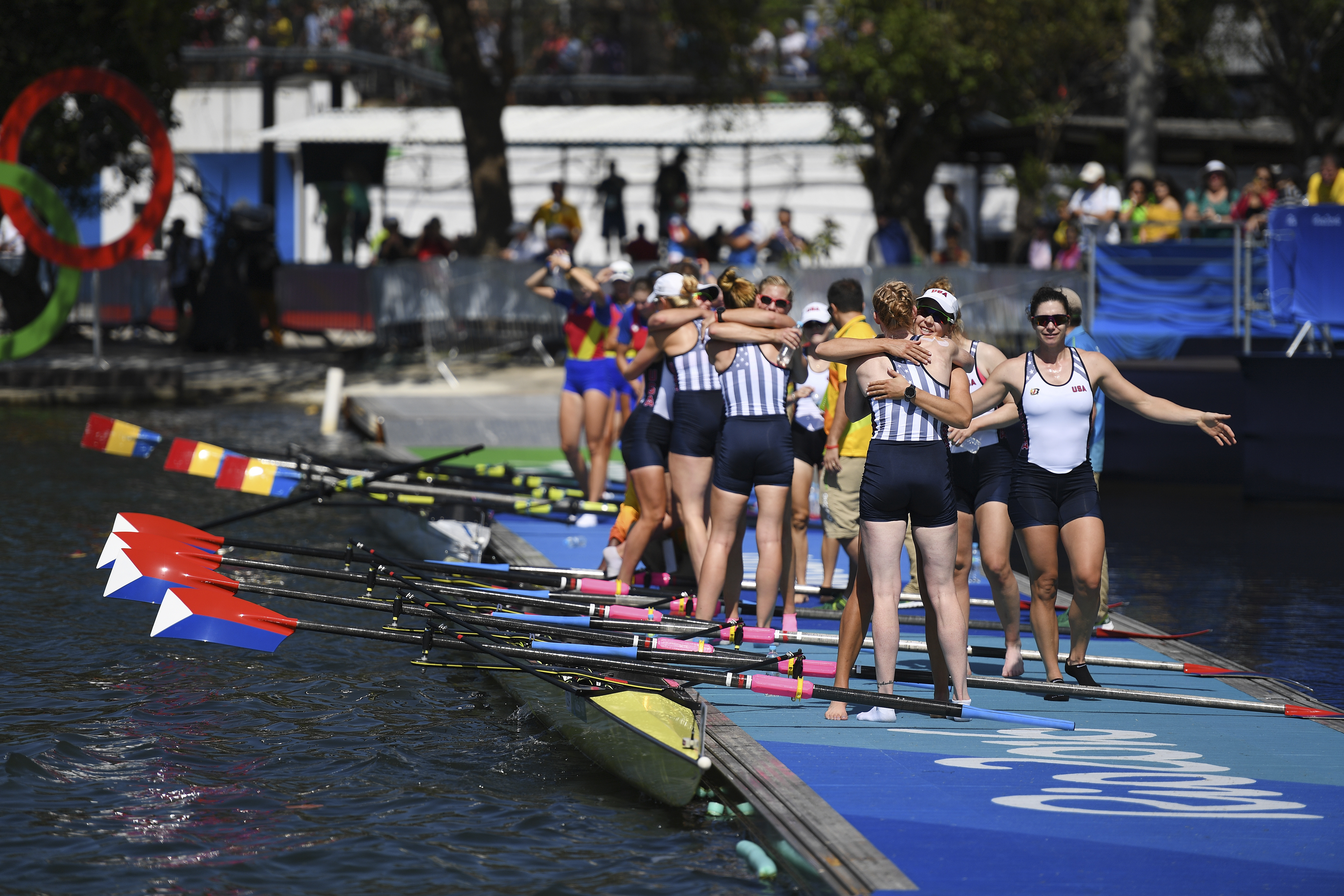 The U.S. women's rowing team celebrates after winning gold in the coxed eight final at Lagoa Stadium during the 2016 Summer Olympics in Rio de Janeiro, Brazil, Aug. 13, 2016. (James Hill/The New York Times)