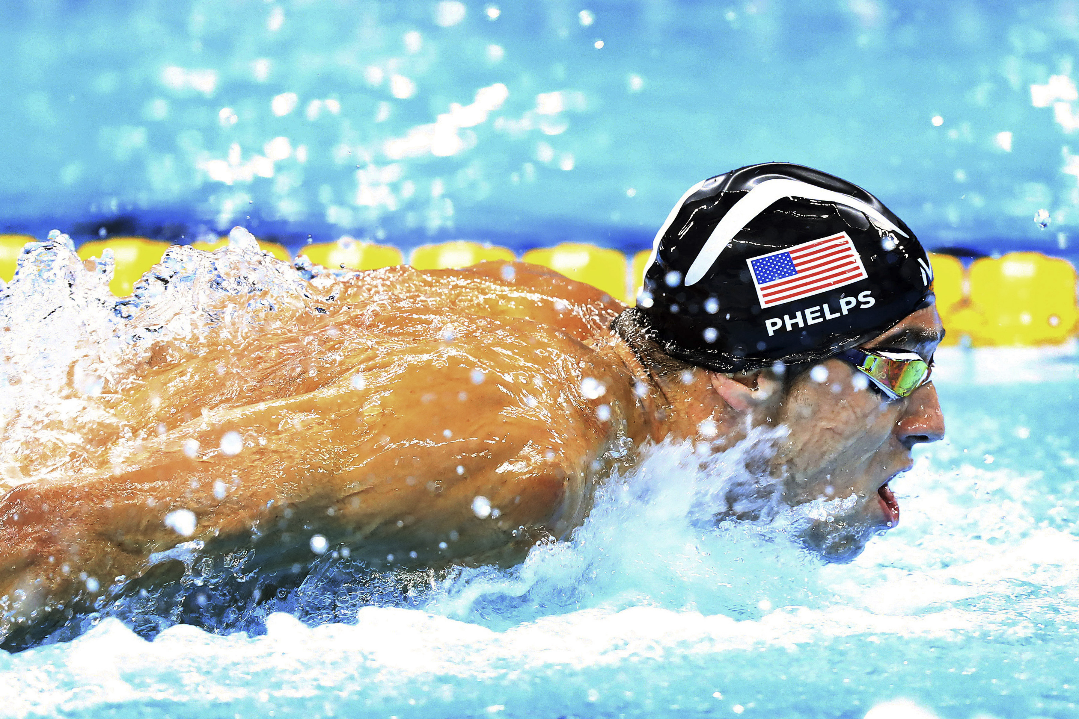 Michael Phelps of the U.S. competes in men's 4x100-meter medley relay final, likely the last race of his career, during the 2016 Summer Olympics at Olympic Aquatics Stadium in Rio de Janeiro. The U.S placed first in the event, earning Phelps his 23rd gold medal. (Chang W. Lee/The New York Times)