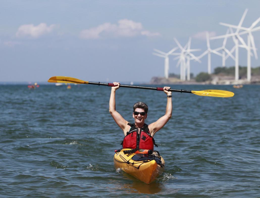 Margaret Kreattz of Buffalo celebrates a kayak race in a  first-of-its-kind regatta at Woodlawn Beach in Hamburg in August 2012. (John Hickey / Buffalo News)