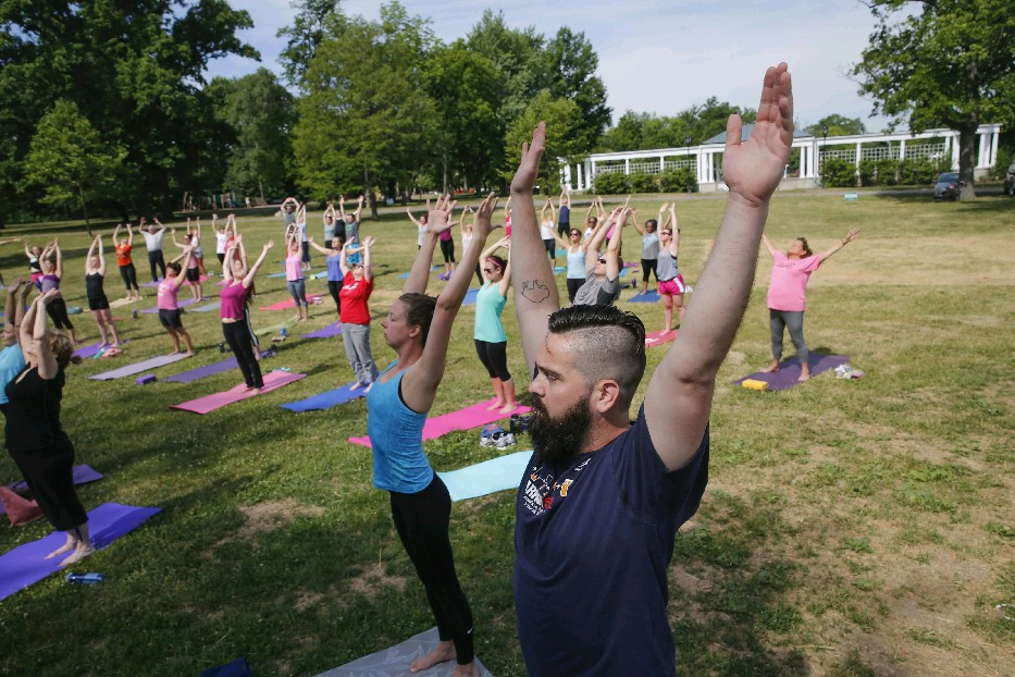 Rob Bari of Buffalo has been among hundreds of people to participate in a Fitness in the Parks yoga class this summer. This is the last week for the outdoor classes for the season. (Photos by Derek Gee/Buffalo News)