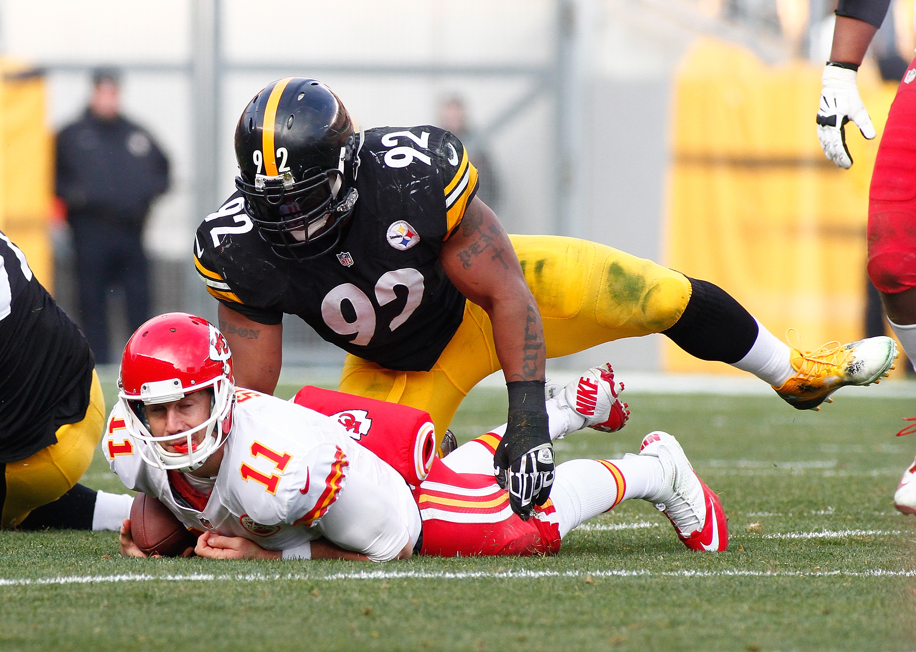 PITTSBURGH, PA - DECEMBER 21: Alex Smith #11 of the Kansas City Chiefs is tackled by James Harrison #92 of the Pittsburgh Steelers during the third quarter at Heinz Field on December 21, 2014 in Pittsburgh, Pennsylvania. (Photo by Justin K. Aller/Getty Images)