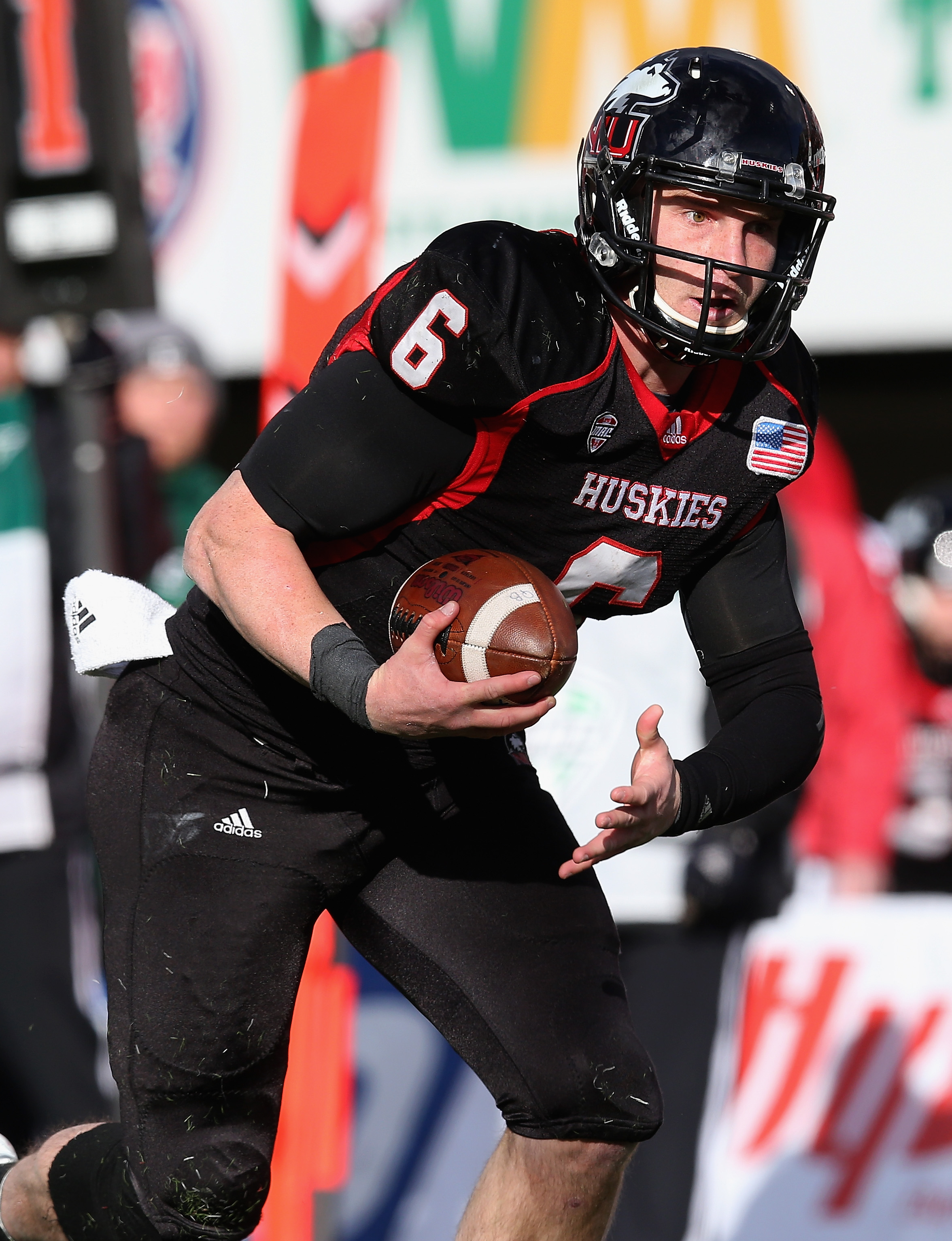DEKALB, IL - OCTOBER 26: Jordan Lynch #6 of the Northern Illinois Huskies runs for a touchdown against the Eastern Michigan Eagles at Brigham Field on October 26, 2013 in DeKalb, Illinois. (Photo by Jonathan Daniel/Getty Images)