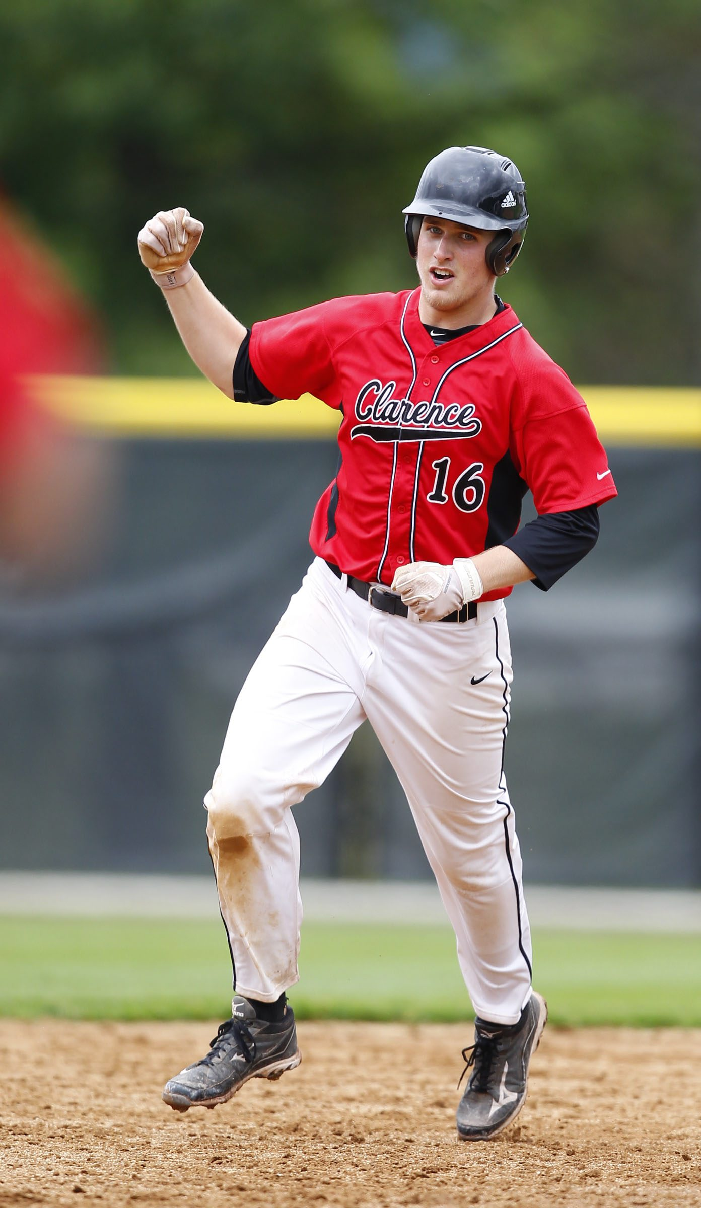 Clarence baseball player, Mark Armstrong, hits a home run and celebrates in 5th inning action, in State semi-final action against Arlington, at SUNY Binghamton, on Saturday, June 8, 2013.Clarence won 5-2.{Photo by Harry Scull Jr. / Buffalo News}