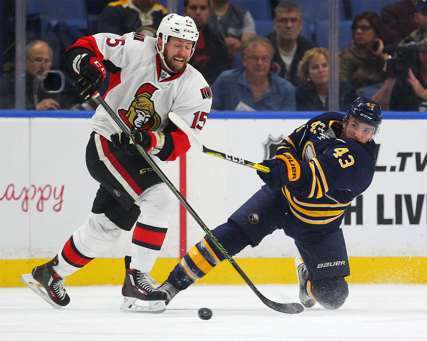 The Sabres' Daniel Catenacci clears the puck from the Senators' Zach Smith in the first period of the game at the KeyBank Center in Buffalo Tuesday, Sept. 27, 2016. (Mark Mulville/Buffalo News)
