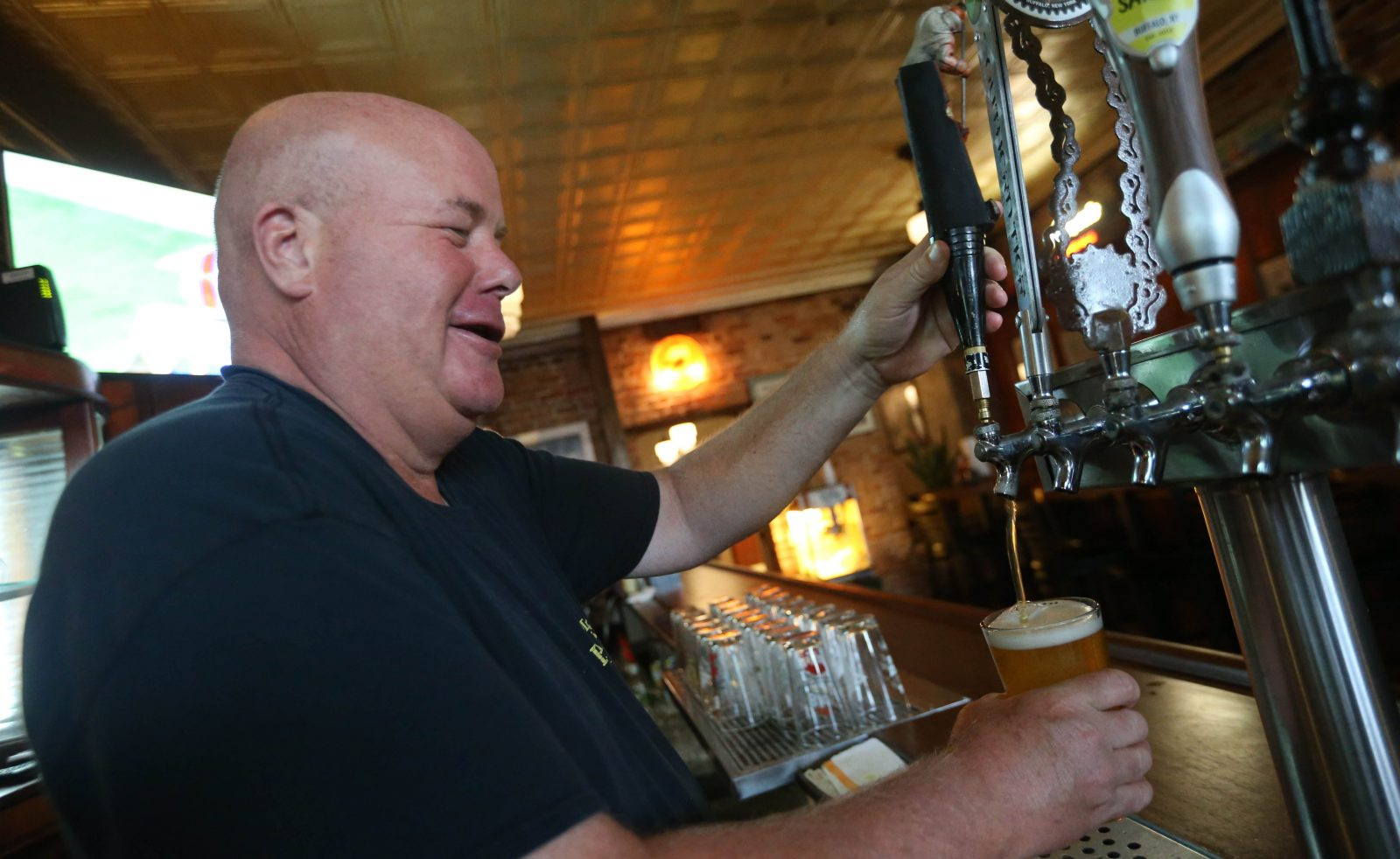 Eddie Brady's co-owner Pat Brady pours a beer.   (Sharon Cantillon/Buffalo News)