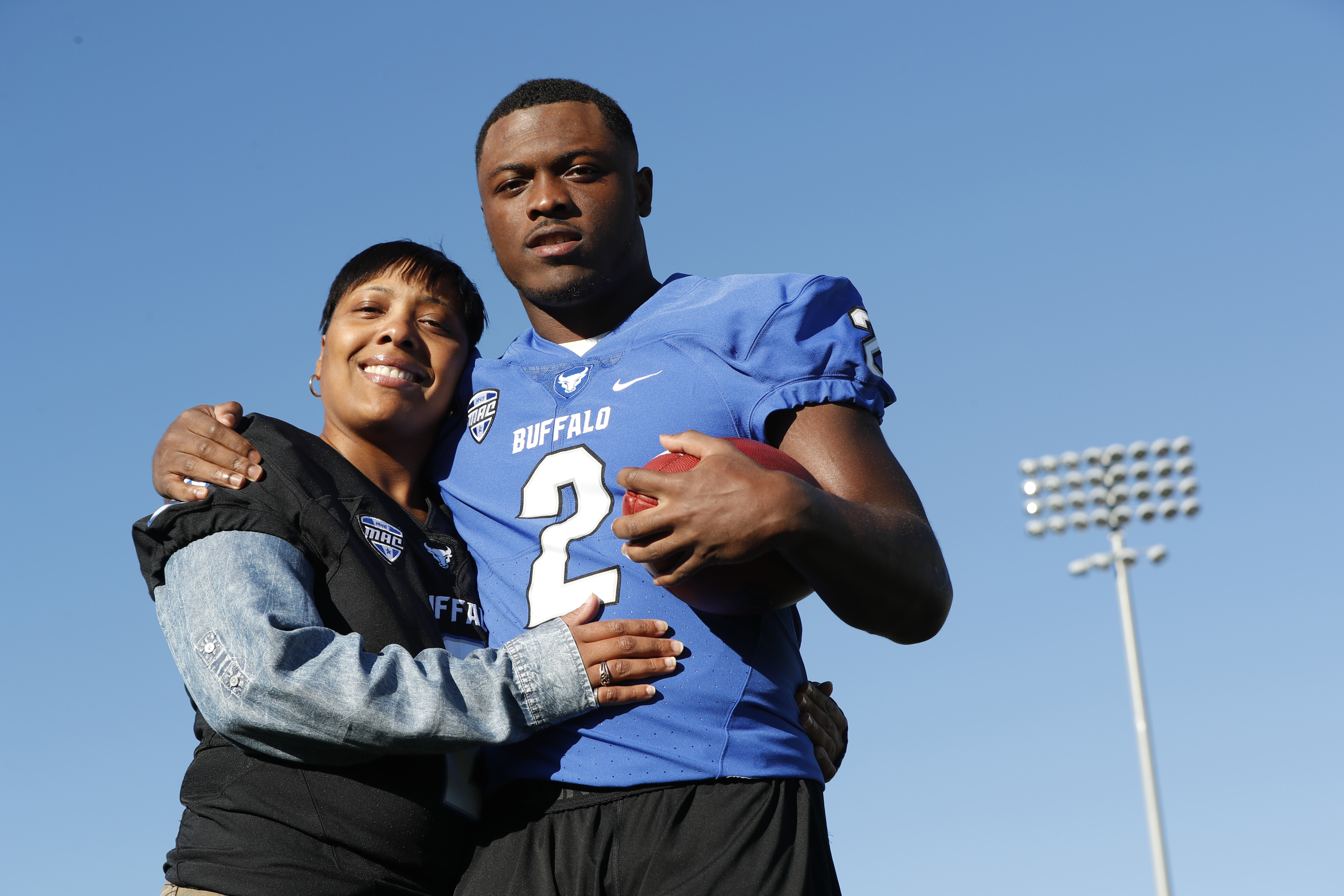 Former UB running back Jordan Johnson, pictured here with his mother, Tameka, is fighting for a spot on the Buffalo Bills' roster. (Harry Scull Jr./Buffalo News)