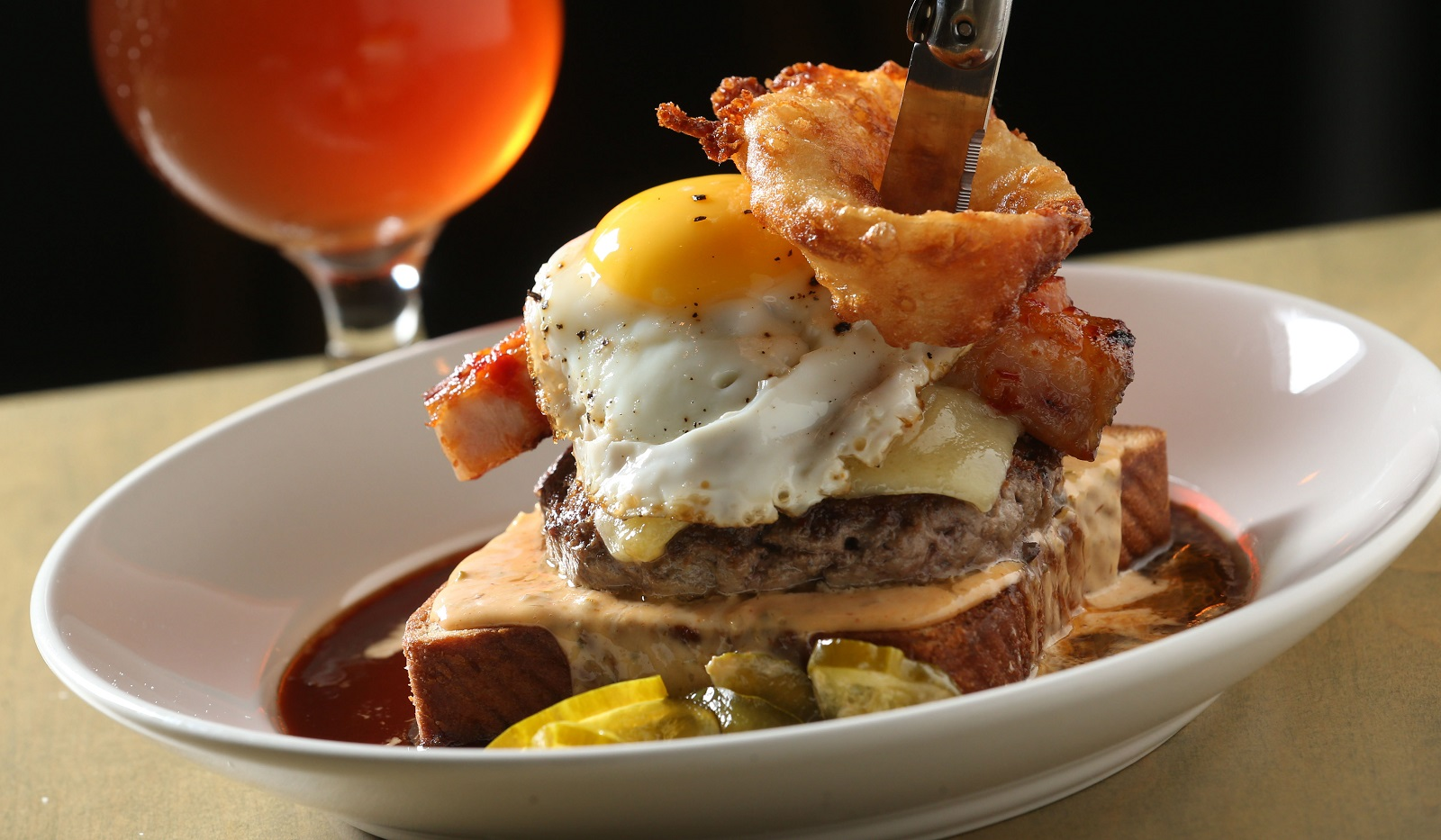 The Tokyo Burger from Thin Man Brewery is a meal for an adventurous and hungry eater. (Sharon Cantillon/Buffalo News)
