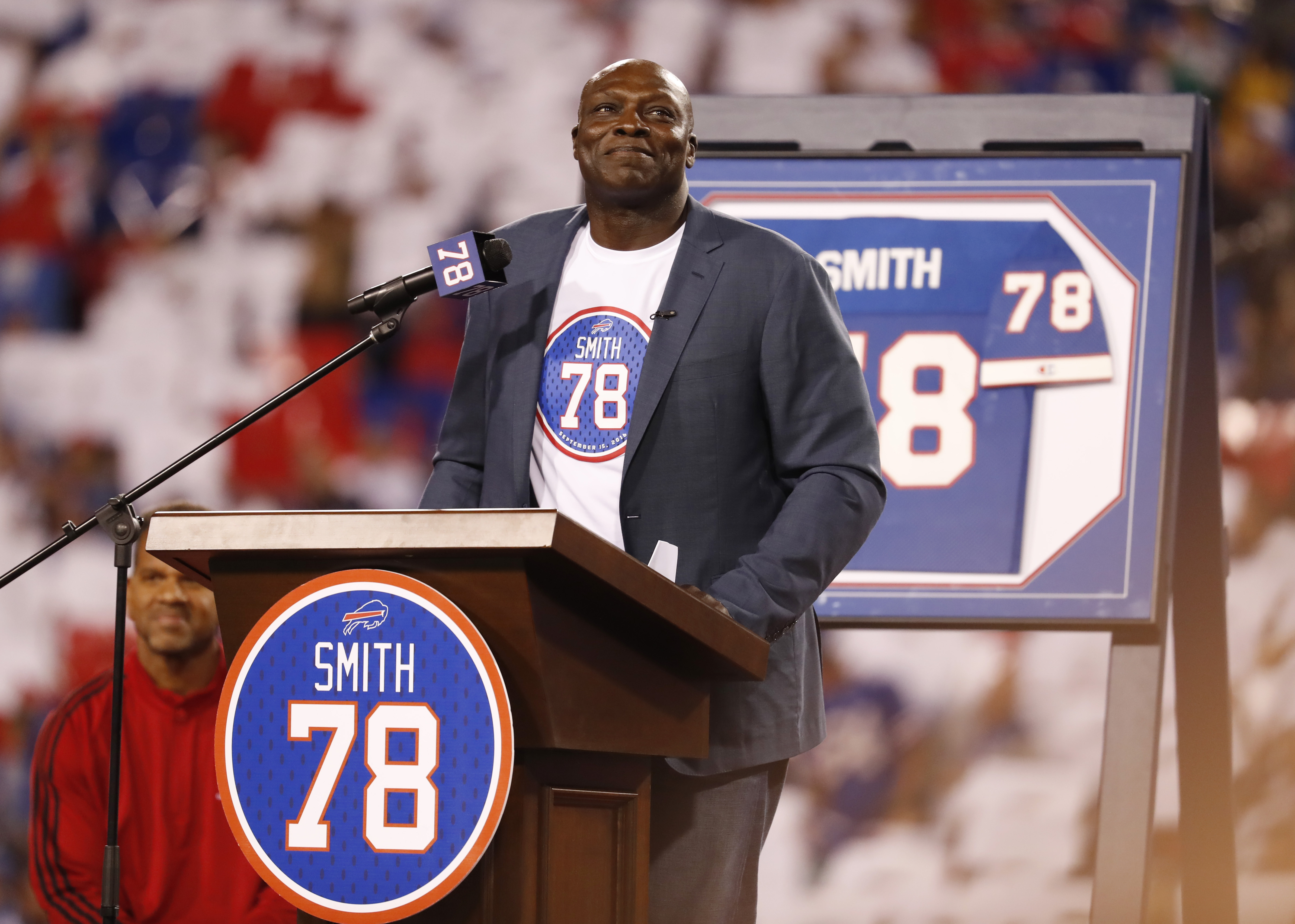 Bills Hall of Famer  Bruce Smith soaks in the applause during his jersey retirement ceremony at halftime. (Harry Scull Jr./Buffalo News)