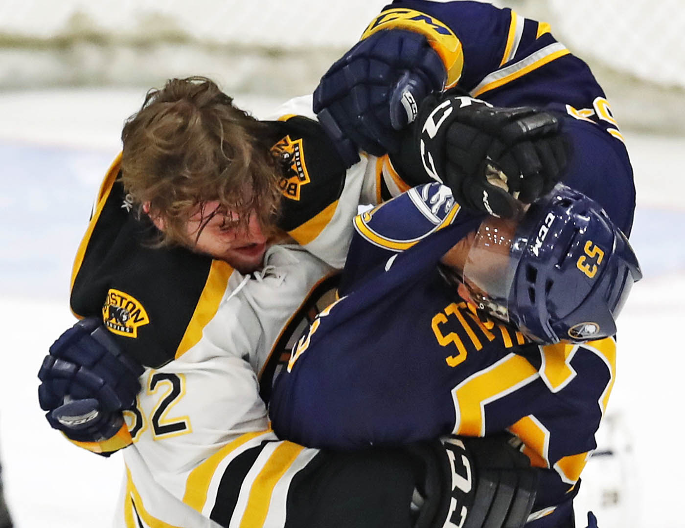 Buffalo Sabres Devante Stephens and Bostin Bruins Jesse Gabrielle get into a scrap during first period action in the prospects game at HarborCenter on Monday, Sept. 19, 2016. (Harry Scull Jr./Buffalo News)
