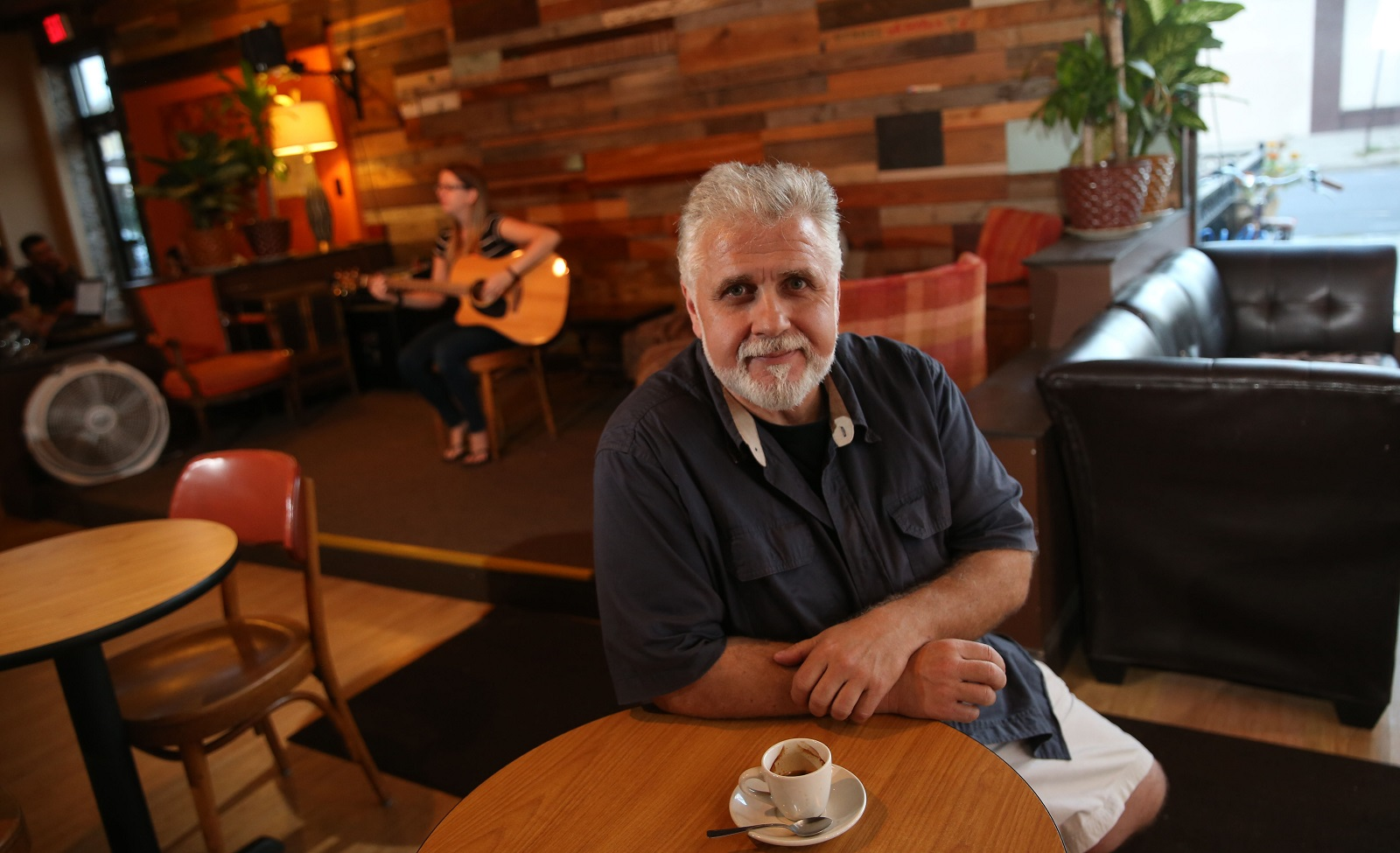 Daily Planet Coffee owner Mike Caputi has a passion for music he brings into his Hertel Avenue coffee shop. (Sharon Cantillon/Buffalo News)