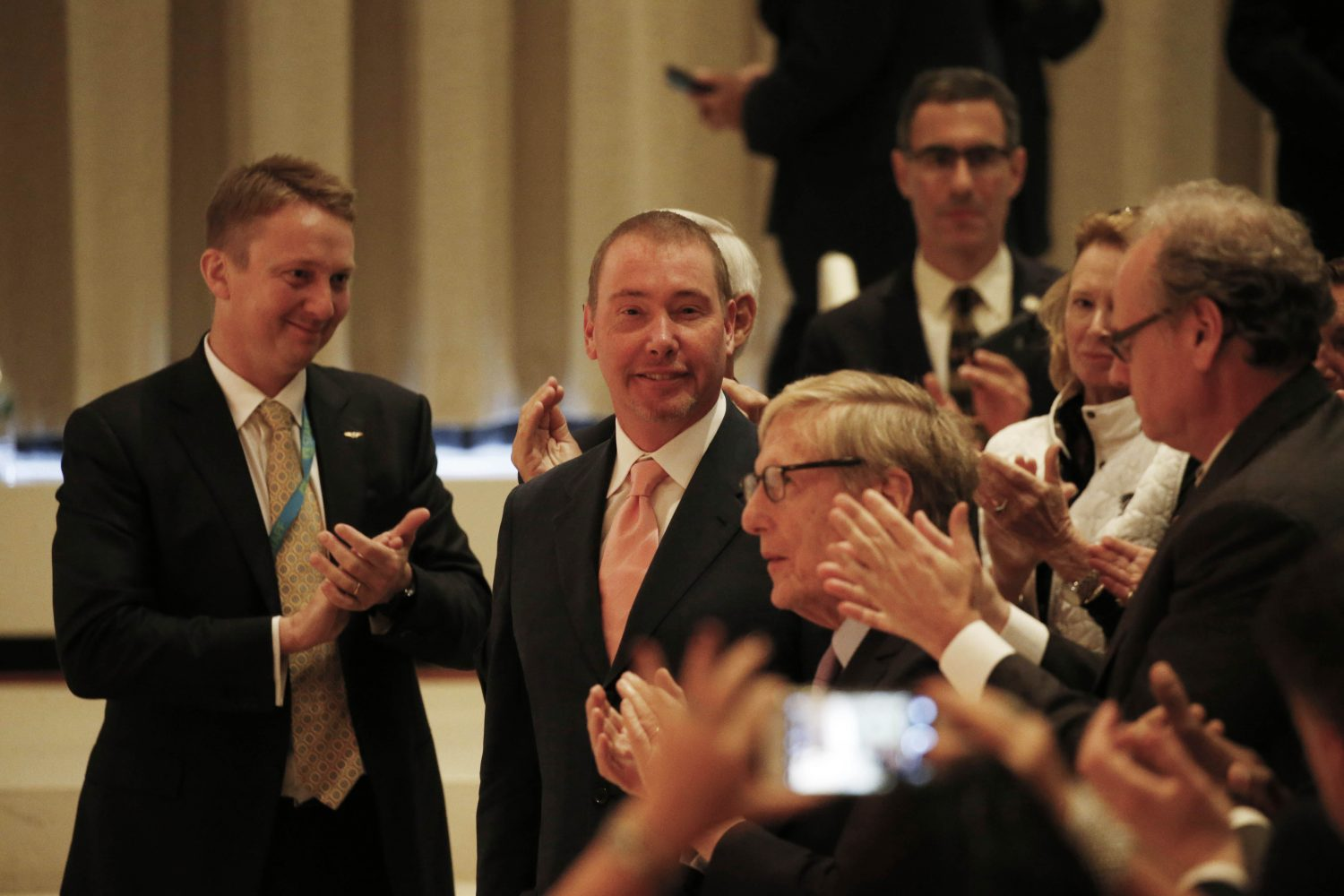 Jeffrey Gundlach, center, accepts the applause as Gov. Andrew Cuomo thanks him for his donation of $42.5 million dollars to the Albright-Knox Art Gallery. (Derek Gee/Buffalo News)