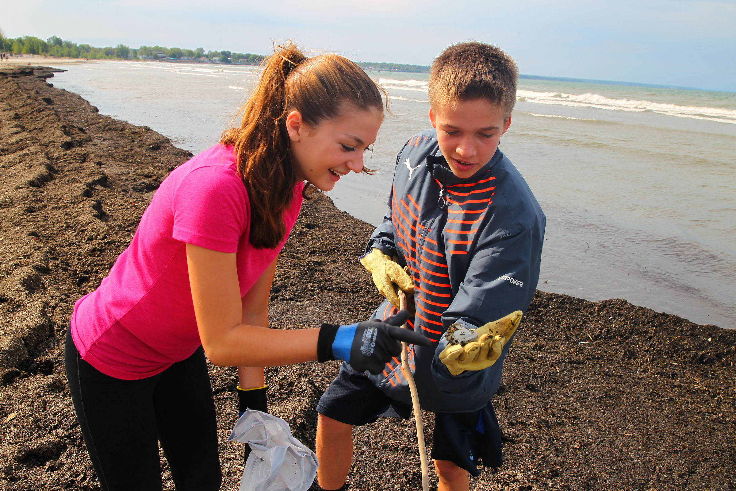 Josh Valentine, 14, right, and Madeline Venturo, 15, from Orchard Park Presbyterian Church look at plastic item he picked up as they volunteered at the 31st annual Great Lakes Beach Sweep helping clean up garbage, including plastic bottles, balloons, cigarette butts and other items from beacheson Saturday Sept. 17, 2016 at Woodlawn Beach State Park , in Blasdell, N.Y.. (John Hickey/Buffalo News)