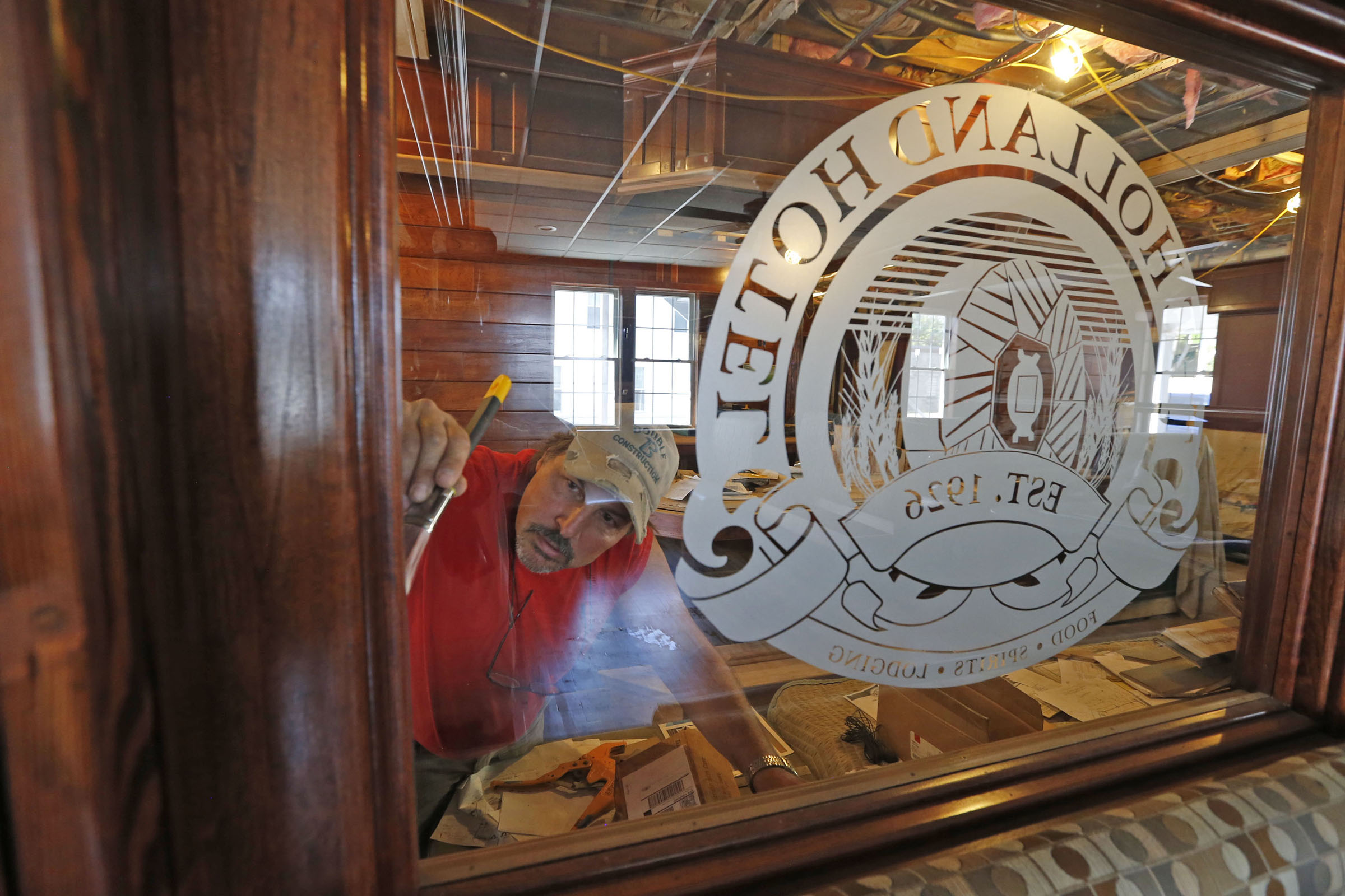 Main Street Monday--- Kevin Pfister, one of the construction foremans at the Holland Hotel remodel varnishes a section of the dining room at said establishment on Main St. in Holland on Monday, Sept. 19, 2016. The 5 room hotel and eatery is scheduled to open just before the Tulip Festival in 2017. (Robert Kirkham/Buffalo News)