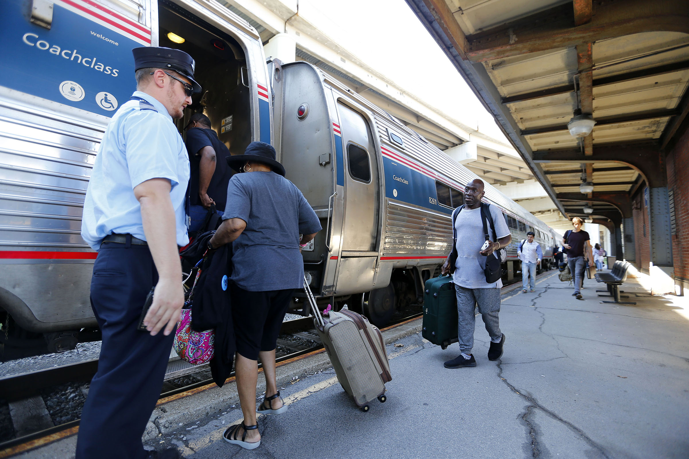 People board an Amtrak train at the Exchange St. station in Buffalo Tuesday, Sept. 20, 2016. (Mark Mulville/Buffalo News)