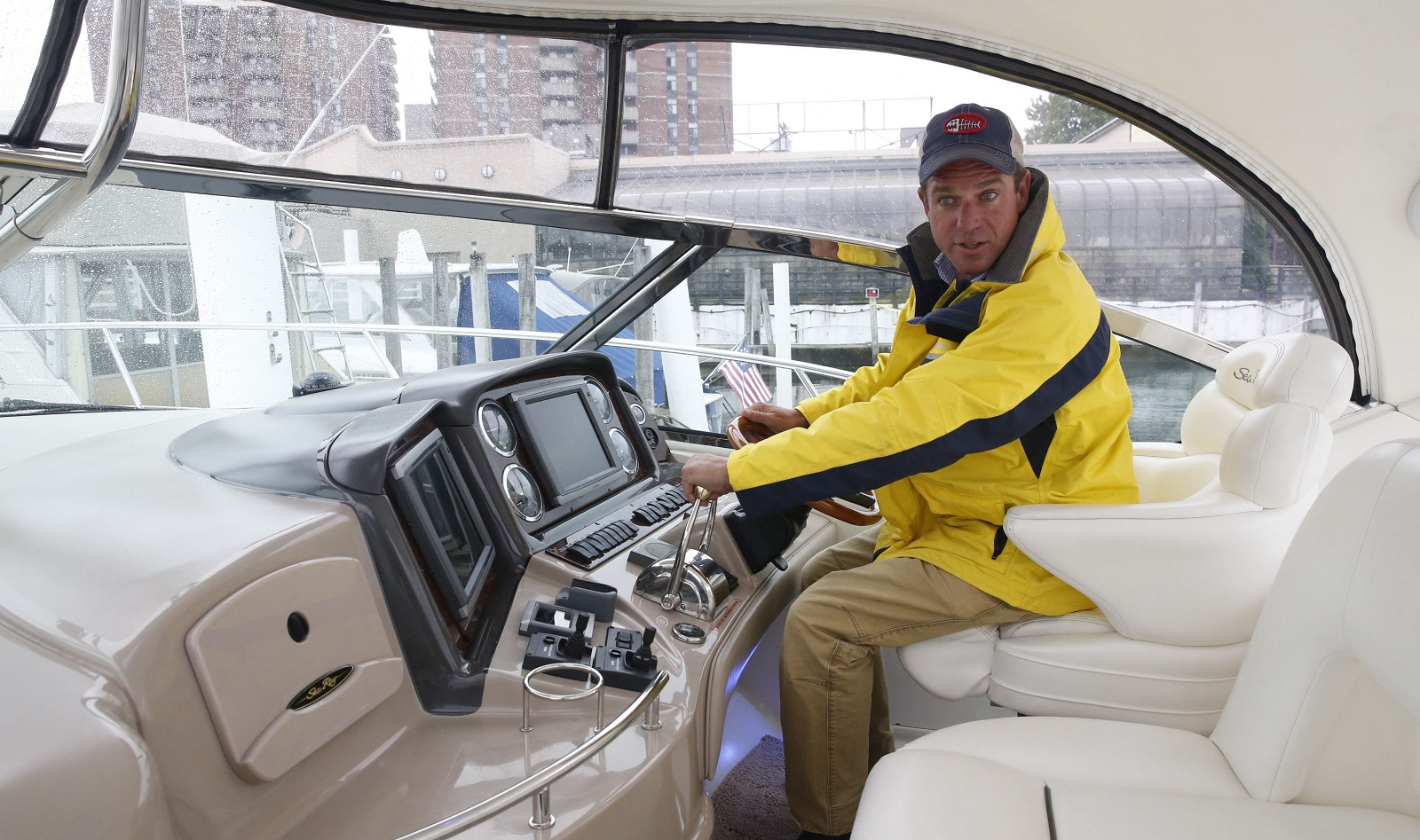 Tucker Curtin steers his 45-foot yacht, which will seat six customers but also can dock to serve customers on shore. (Robert Kirkham/Buffalo News)
