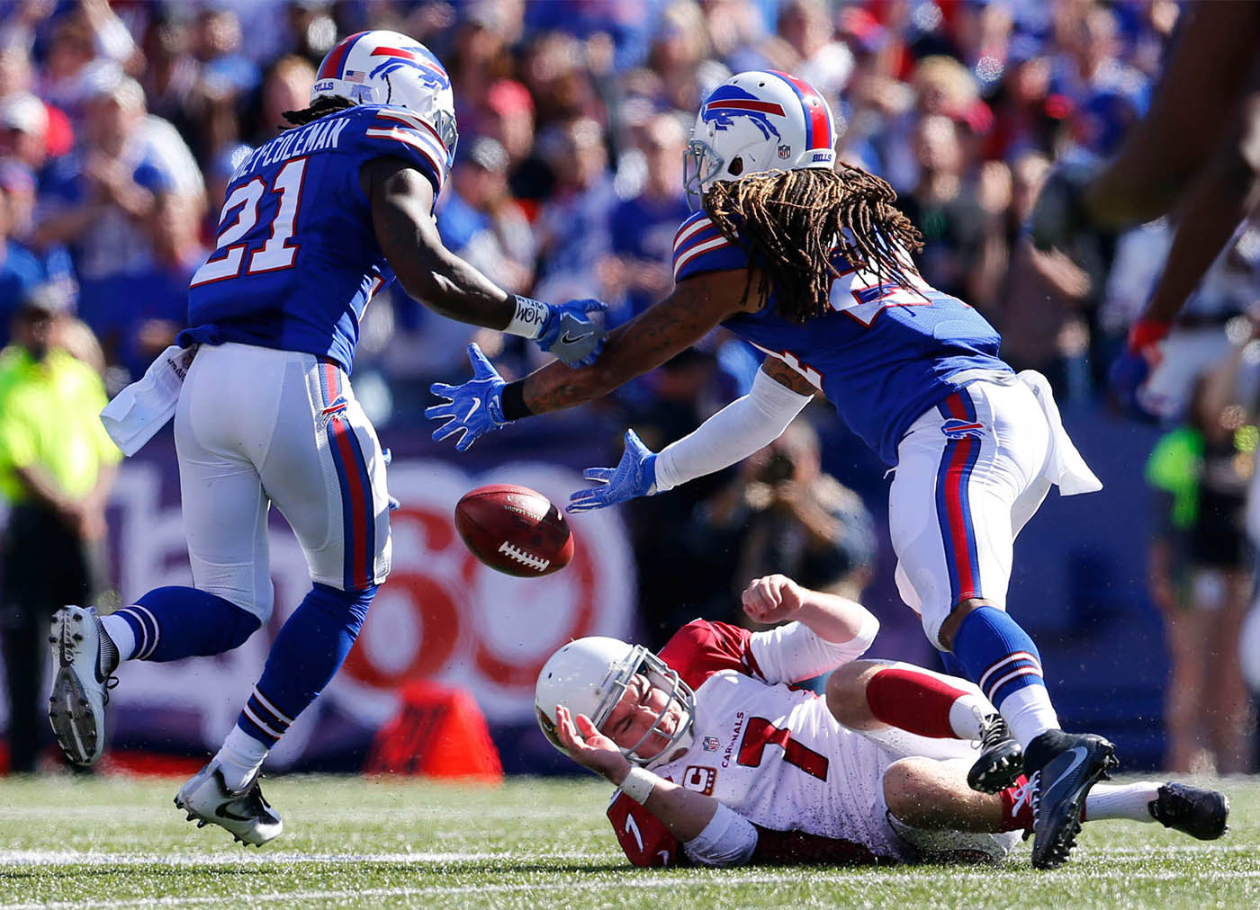 Arizona Cardinals kicker Chandler Catanzaro can't hang on to the ball after a botched snap on a field goal attempt as Buffalo Bills corners Nickell Robey-Coleman (21) and Stephon Gilmore, right, chase down the ball during the third quarter at New Era Field in Orchard Park, Sunday, Sept. 25, 2016. The ball was recovered by Buffalo's Aaron Williams, who returned it for a touchdown. (Mark Mulville/Buffalo News)