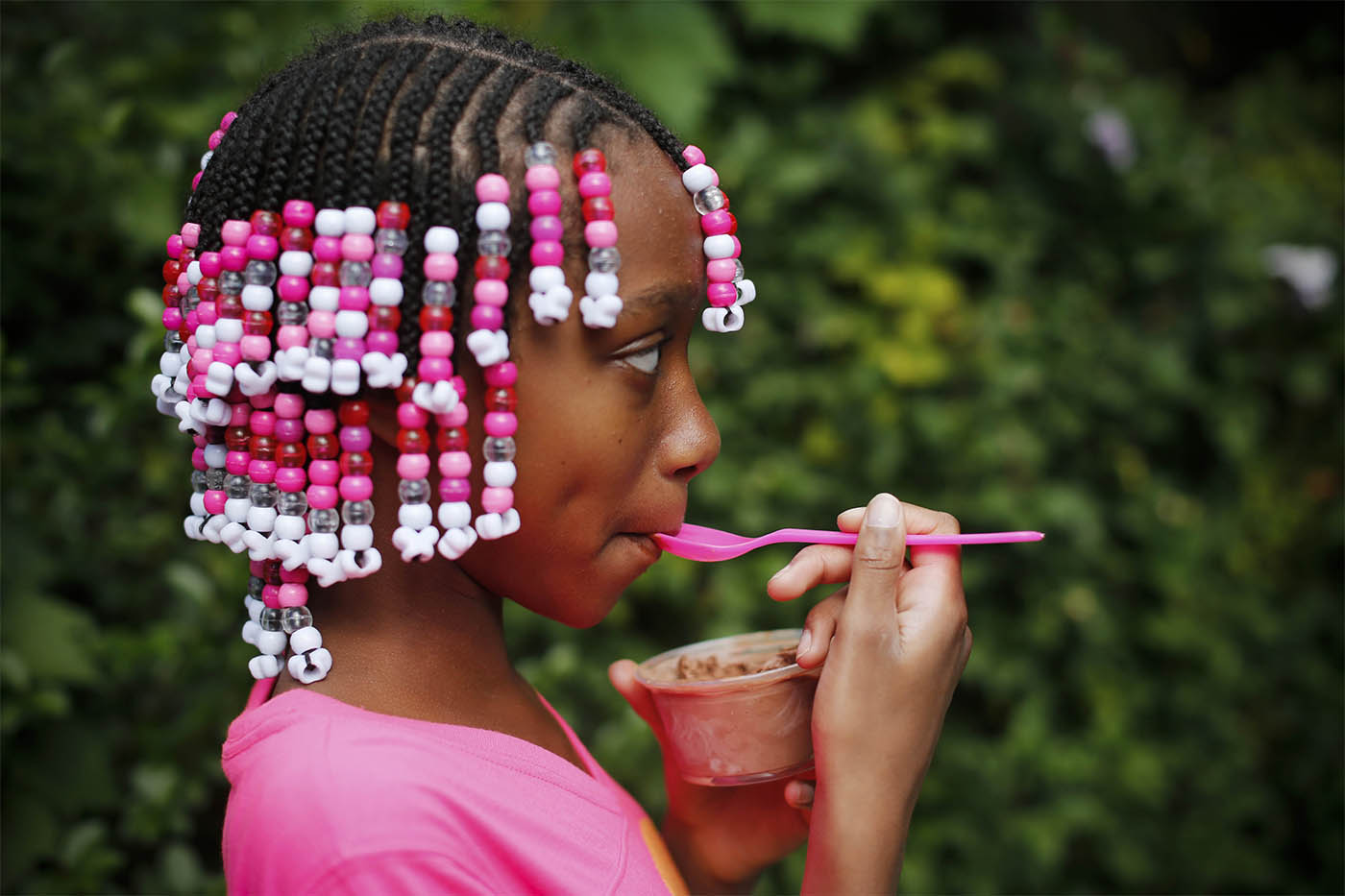 Genesis Dixon, 9, is a study in pink as she enjoys an ice cream from Fowlers Chocolate in the Elmwood Village on Saturday, Sept. 24, 2016. (Derek Gee/Buffalo News)