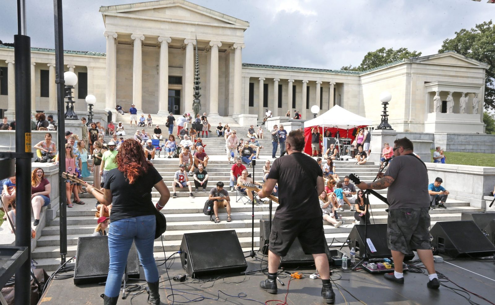 """From right, Rosie Lorenti, Billy Horn and Doug Life from the band """"Billy Draws 2"""" perform on the main stage at the 14th annual Music is Art Festival behind the Albright- Knox Art Gallery in Delaware Park Saturday. The festival, conceived by the Goo Goo Dolls' Robby Takac, featured more than 100 musical acts."""