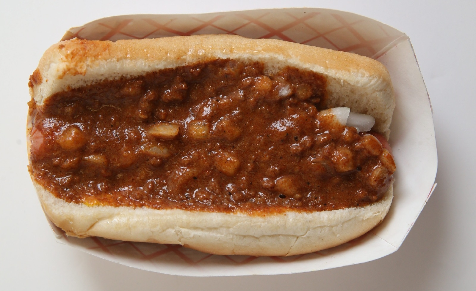 Louie's Texas Hots has opened a new location in North Tonawanda, the local chain's first venture into Niagara County. Here's a Texas hot with onions and mustard. (Sharon Cantillon/Buffalo News file photo)