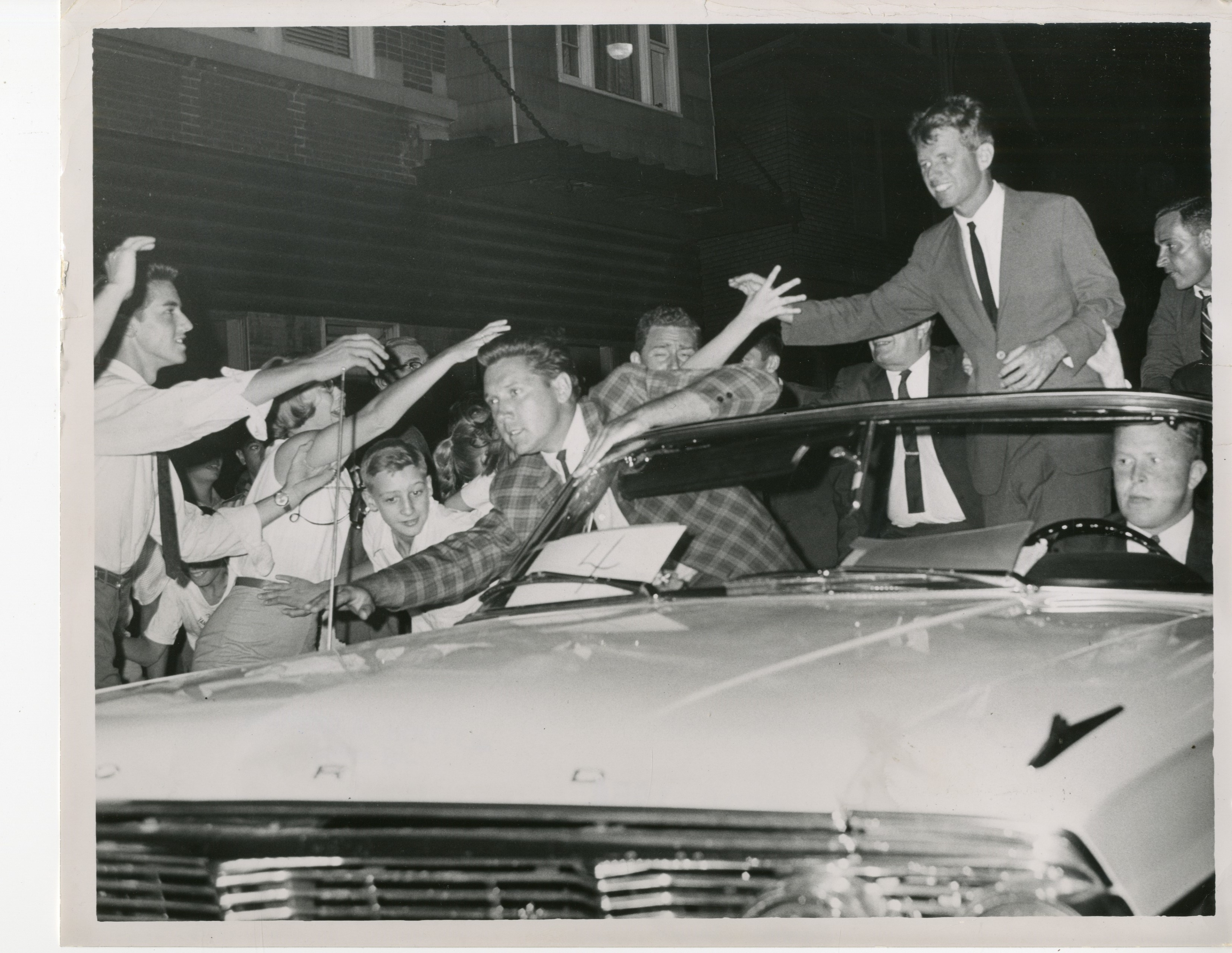 Robert Kennedy gets an enthusiastic welcome in Western New York as motorcade passes. (News file photo)