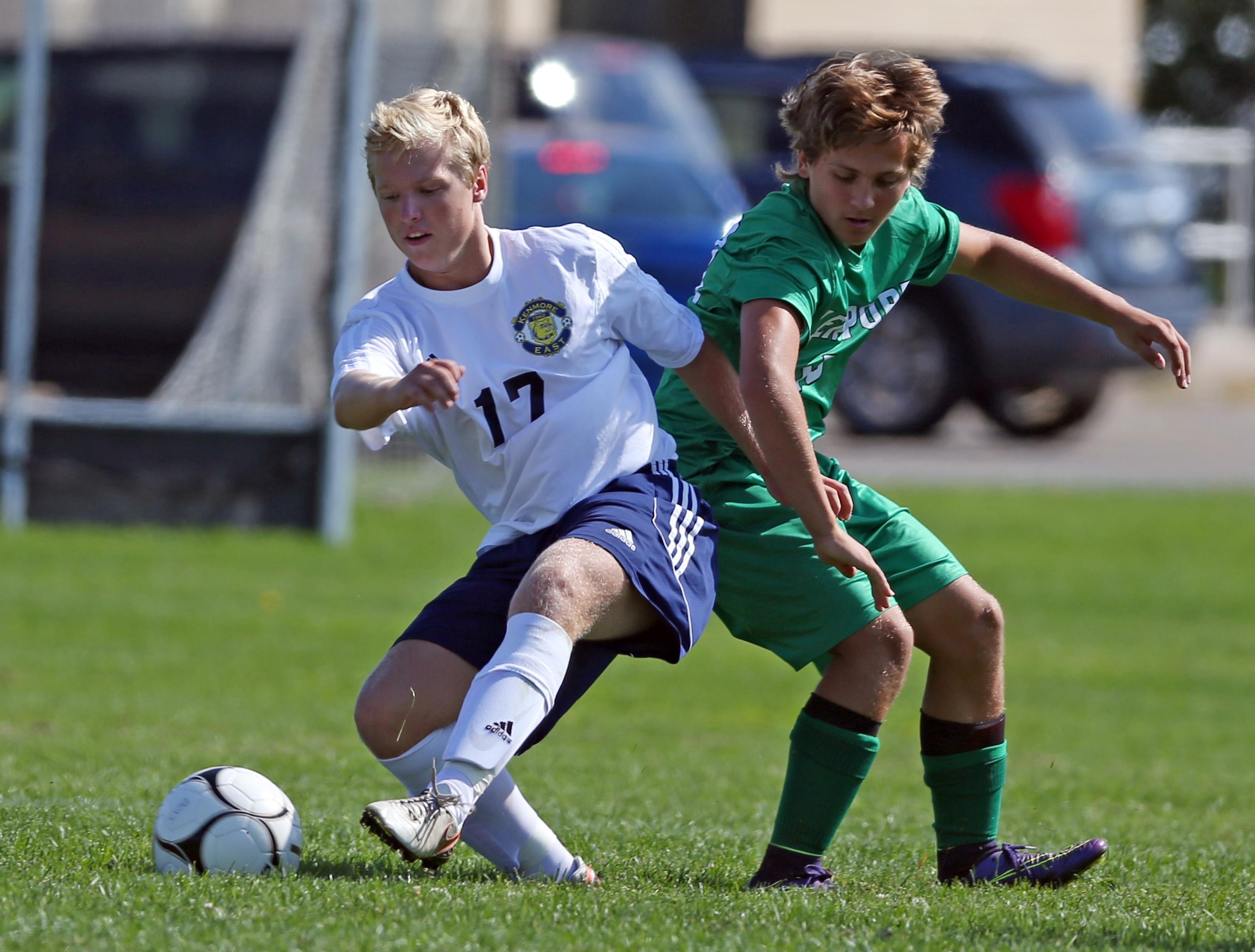 Kenmore East's Brett Wilkinson, left, battles Lewiston-Porter's Joey Zachary in their Niagara Frontier League soccer game Saturday. (James P. McCoy/Buffalo News)
