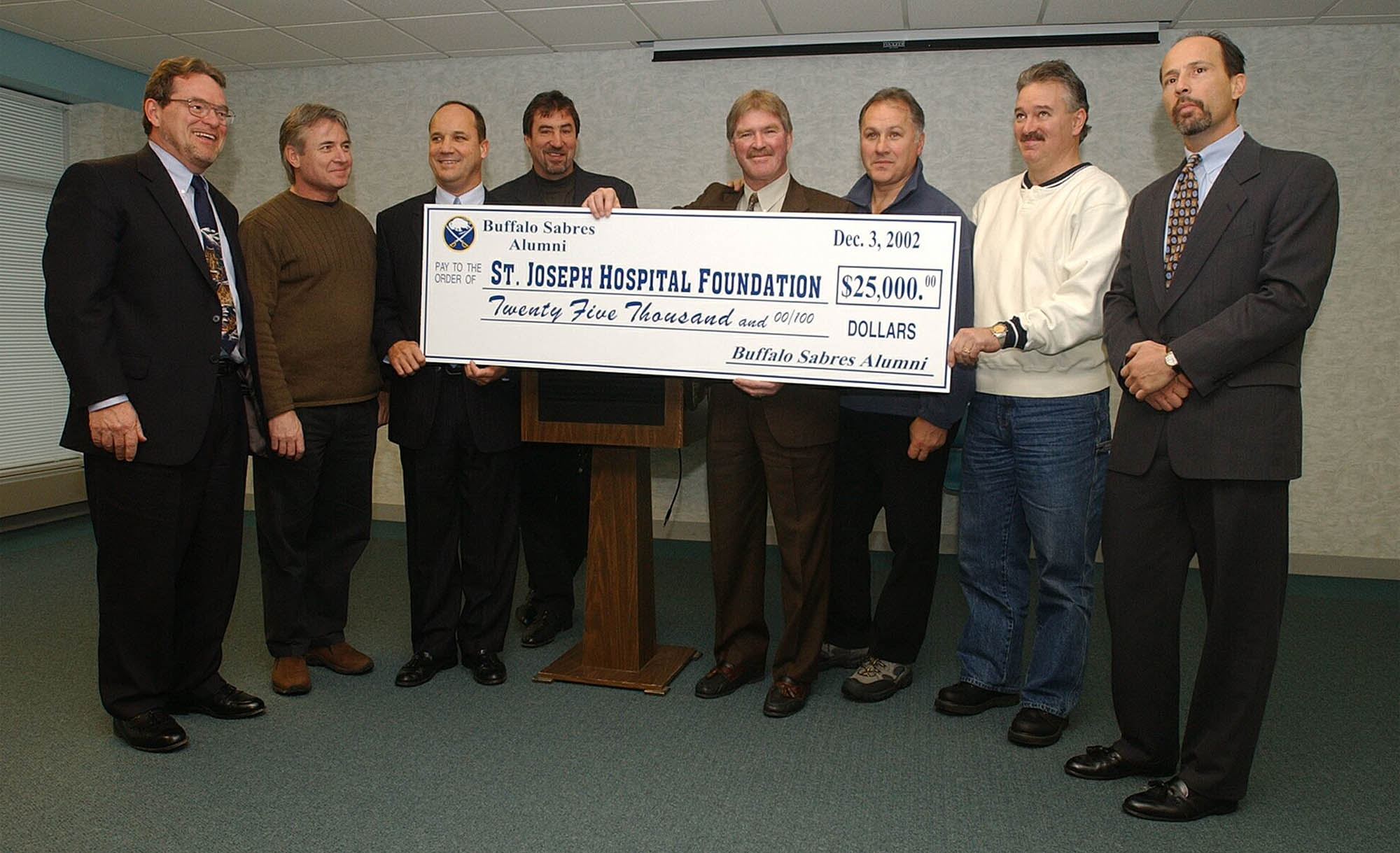 Buffalo Sabres Alumni donate $25,000.00 to the St. Joseph Hospital  Foundation on Dec. 3, 2002. Pictured from left to right: Michael W. Gerrity, President of St. Joseph Hospital Foundation; Buffalo Sabres alumni Rene Robert,  Derek Smith, Larry Playfair, Rick Martin, Gilbert Perreault, and Richie Dunn; at far right is James Manzella, St. Joe's chairman of the foundation board. (Harry Scull Jr./Buffalo News)