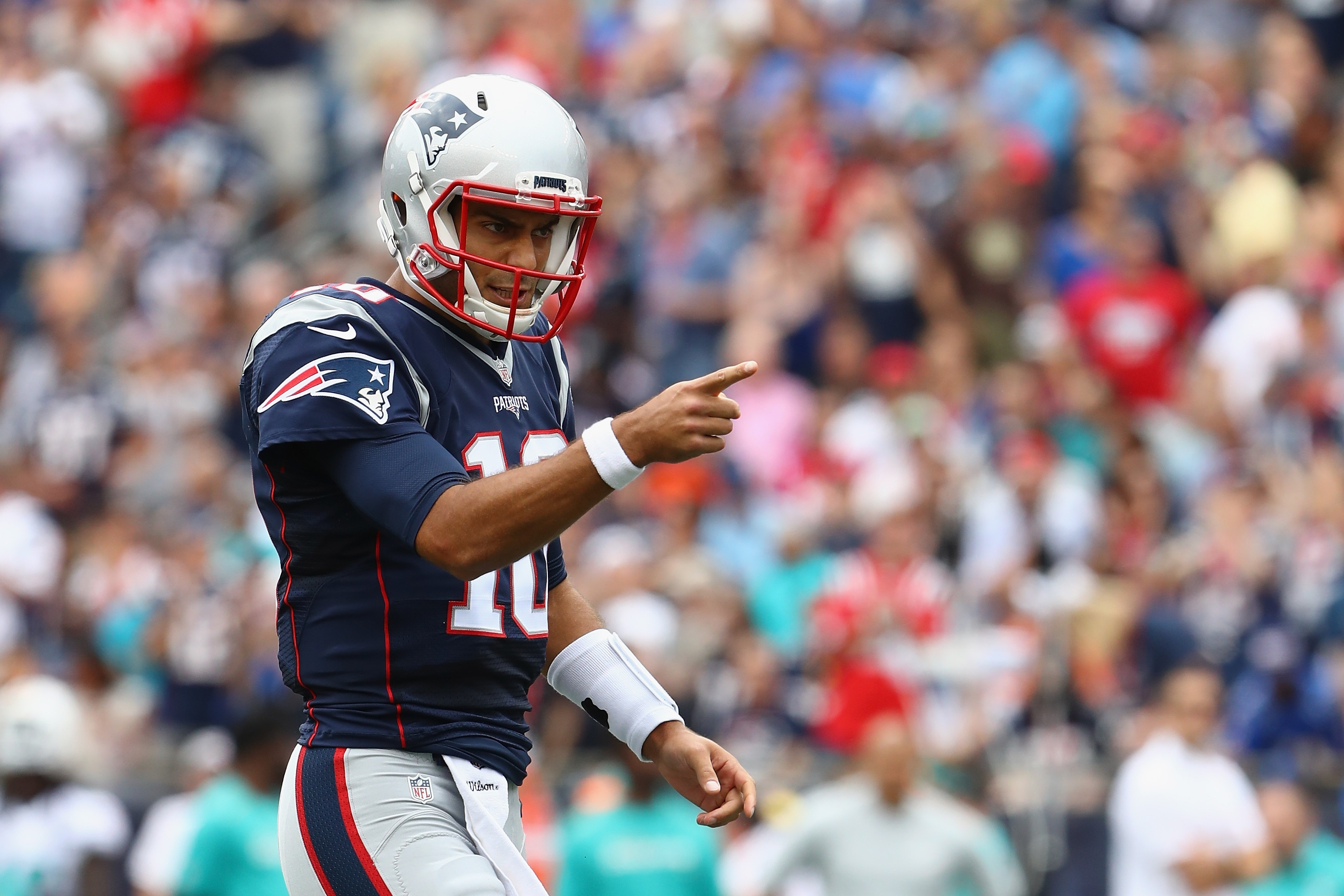 Jimmy Garoppolo reacts during the first half of the Patriots' win over the Miami Dolphins Sunday.