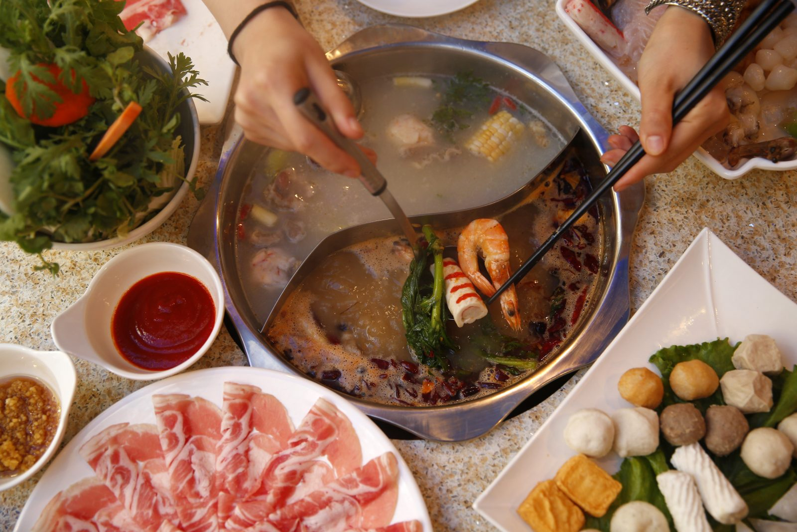 A hotpot features seafood, beef, lamb, meatballs and lots of vegetables at Little Lamb in Amherst. (Sharon Cantillon/Buffalo News)