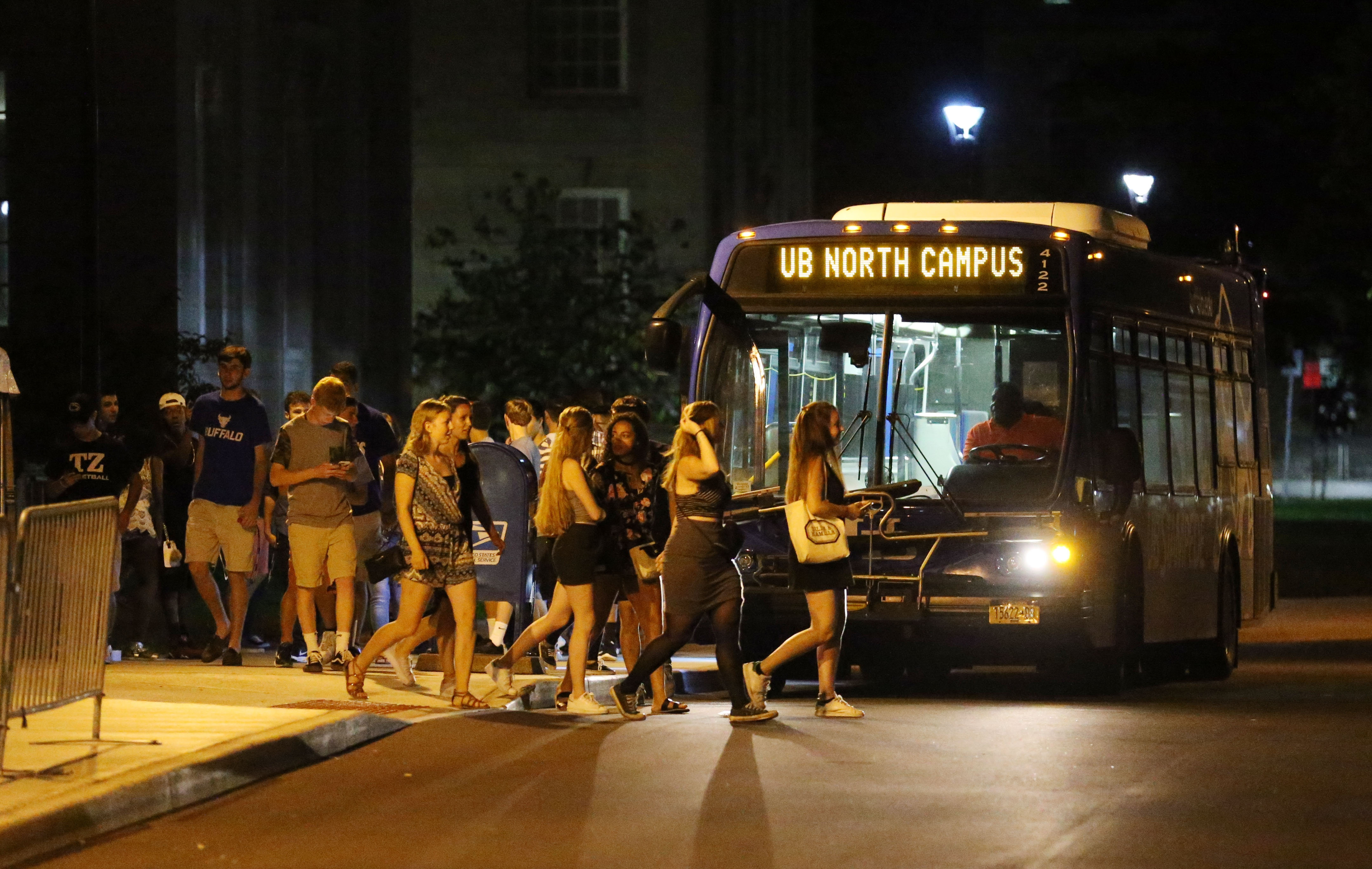 UB students head off a bus at the South Campus in search of house parties in nearby University Heights.