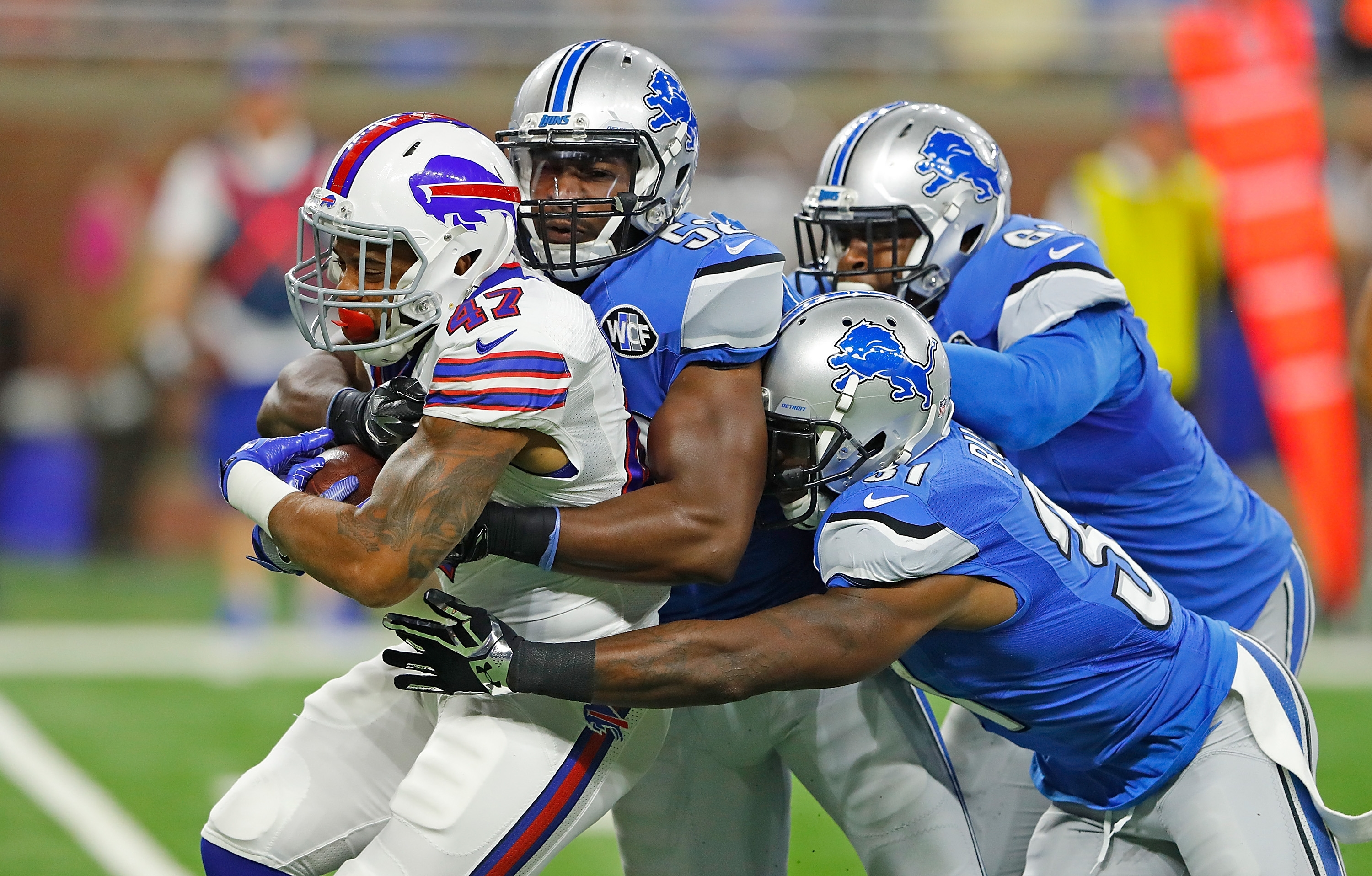 Dan Herron gets wrapped up by the Lions defense.
