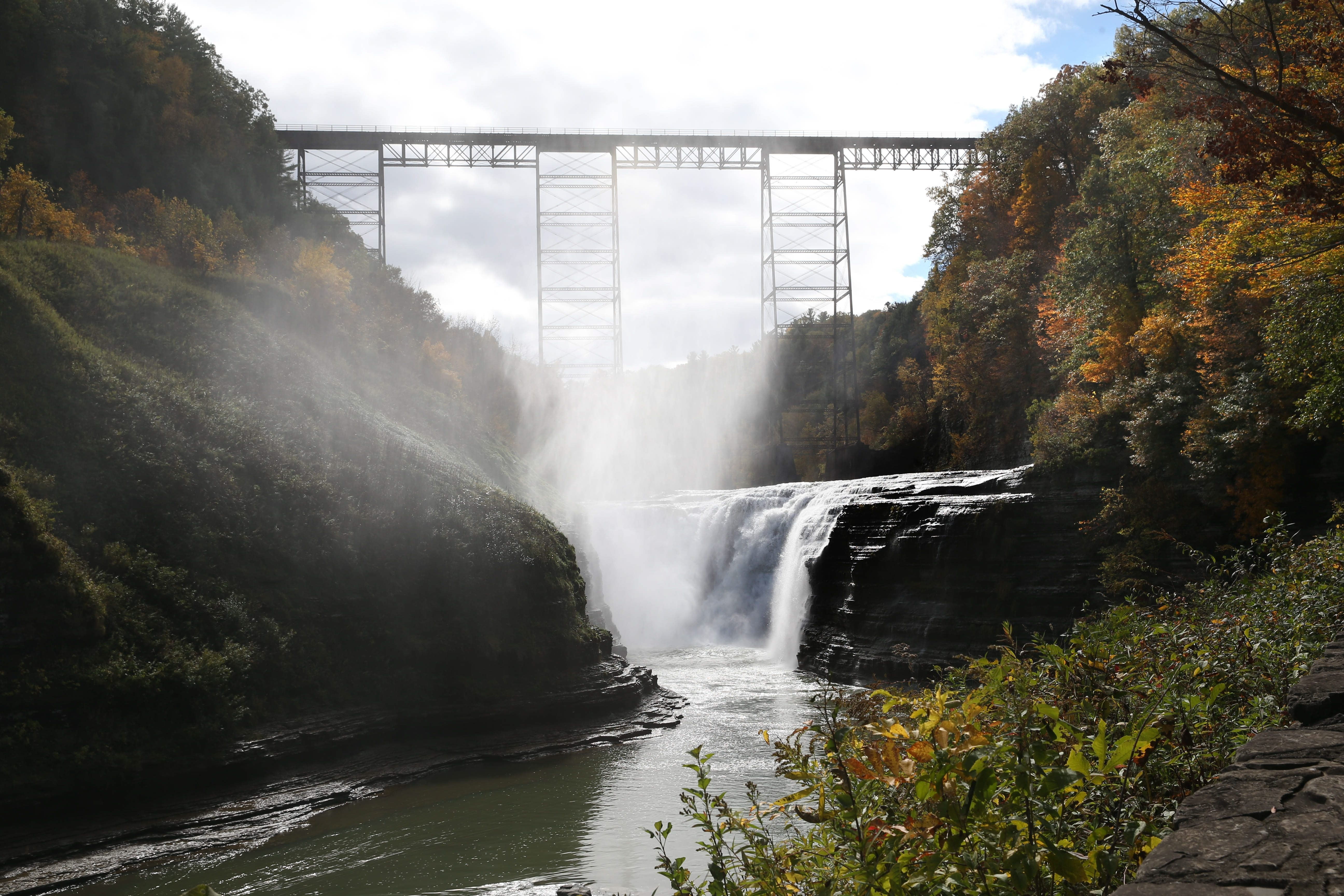 Letchworth State Park, sometimes called the Grand Canyon of the East draws a multitude of visitors annually who come to see the three waterfalls,  the steep walls of the canyon with the Genesee River winding through.  The most popular time of year is in October when tourists come to see the magnificence of the changing leaves in this majestic setting.  Photo taken, Wednesday, Oct. 14, 2015. This is the upper falls. (Sharon Cantillon/Buffalo News)