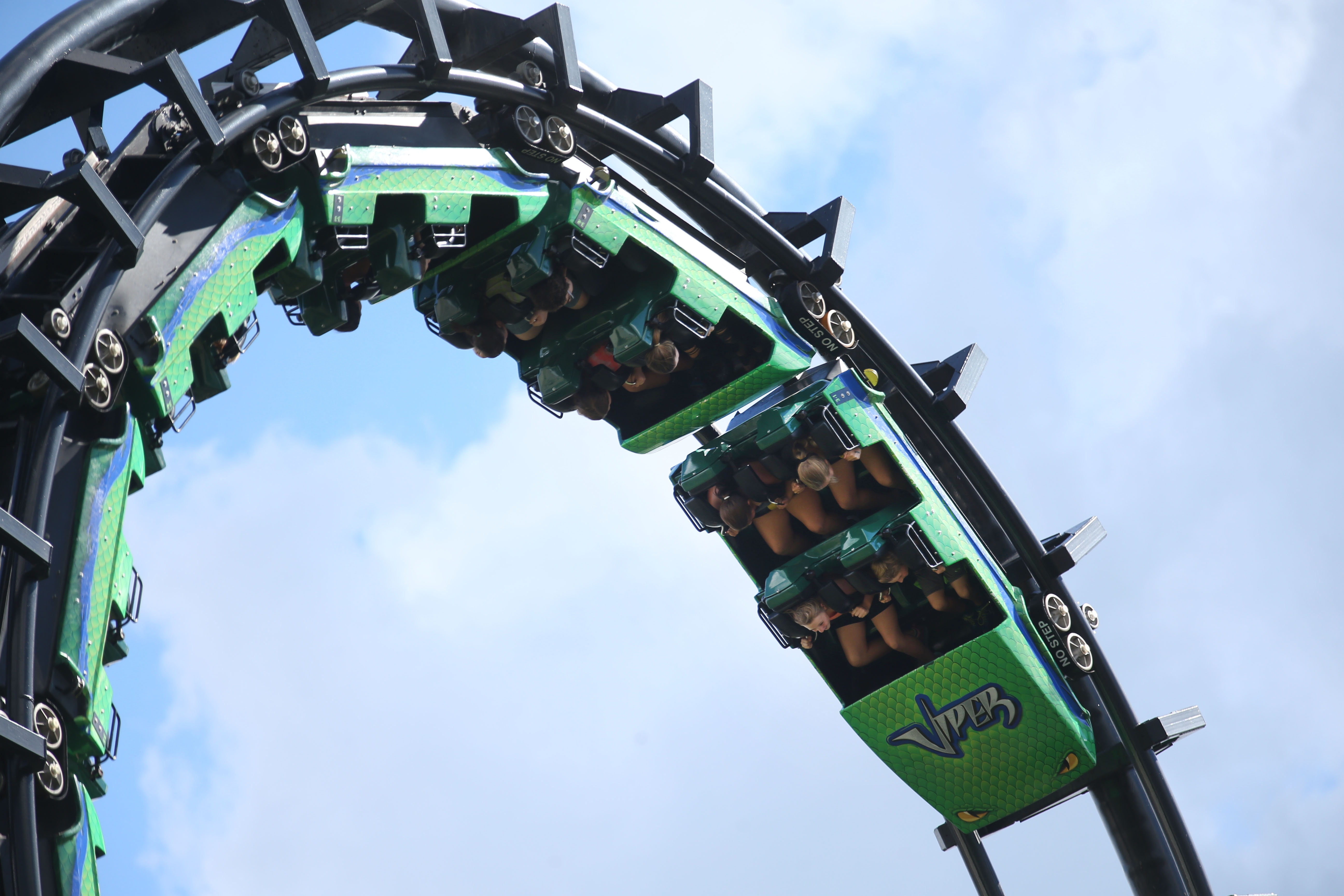 Darien Lake's oldest roller coaster, the Viper, which turned 34 this year is still considered by some to be the best ride in the park.  Visitors enjoy the ride, Thursday, Sept. 1, 2016.  There are several points along the ride where the riders are upside down.  (Sharon Cantillon/Buffalo News)