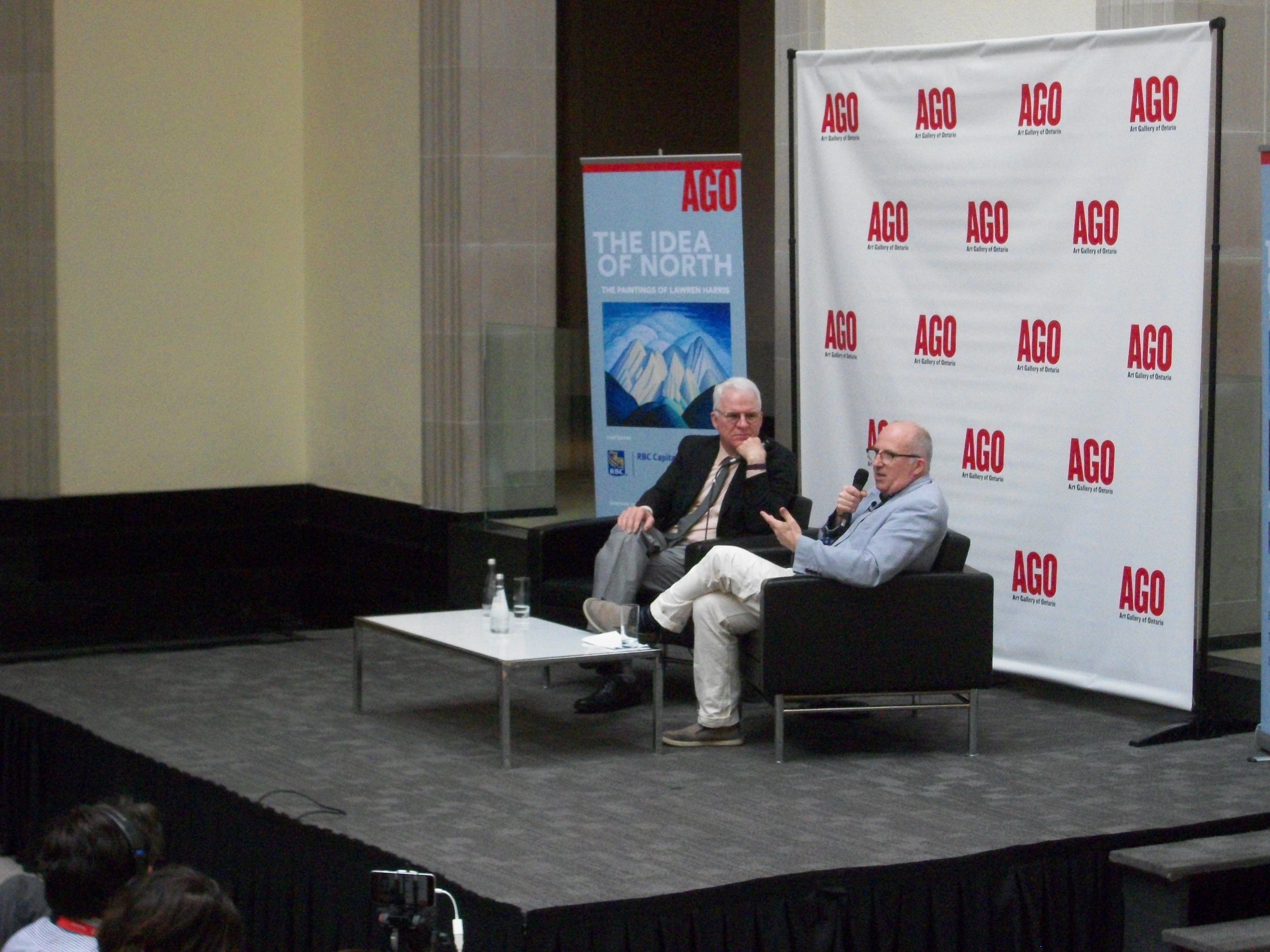 """Steve Martin, left, and  Andrew Hunter, Art Gallery of Ontario's curator of CanadianArt, introduce """"The Idea of North: The Paintings of Lawren Harris,"""" an exhibit Martin is curating  for the Toronto gallery. The exhibit runs through Sept. 18."""