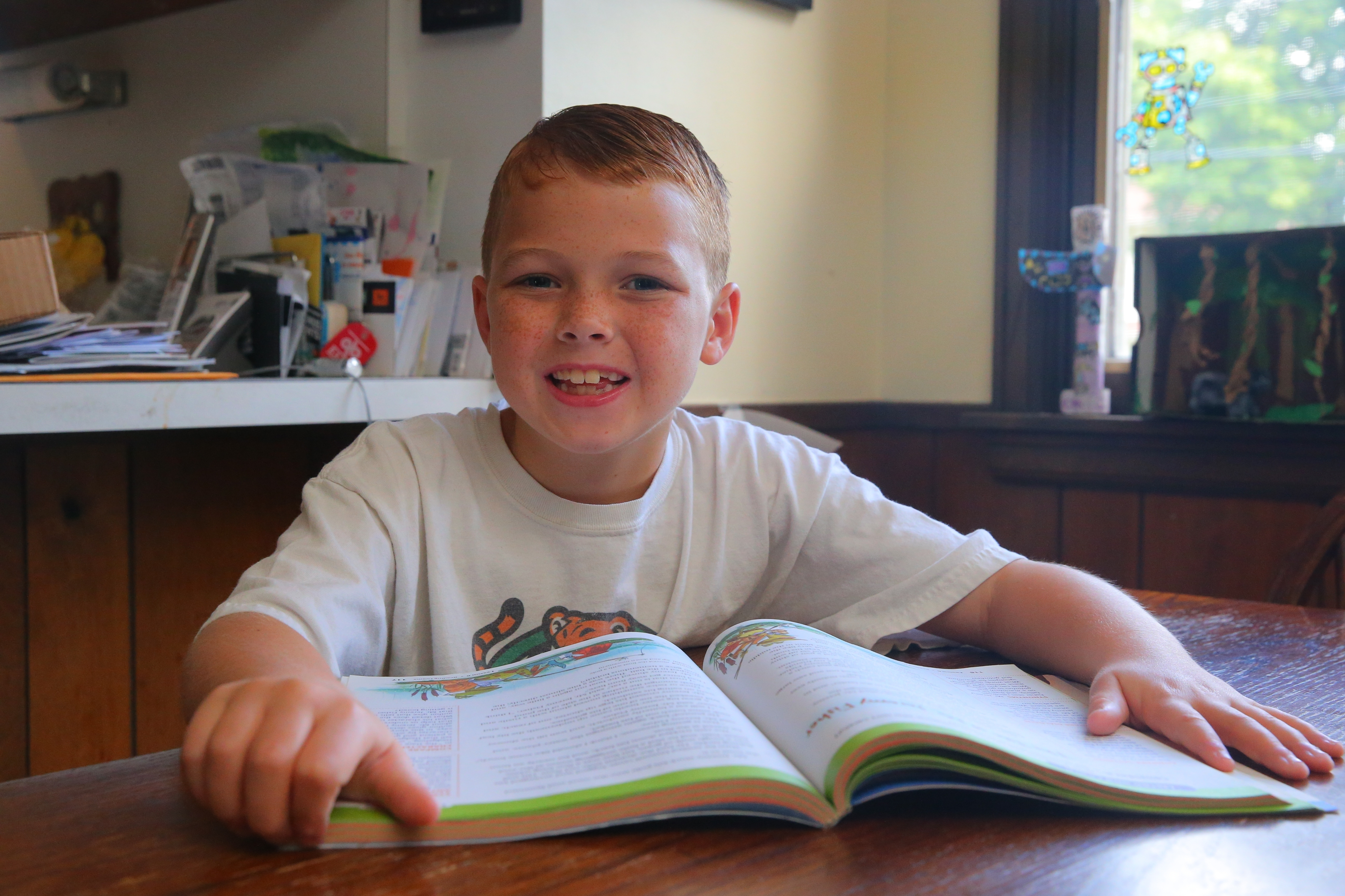 Patrick Connors, 8, cannot wait to start the third grade. Patrick took some time out of his play day to tell others how to survive the first grade.