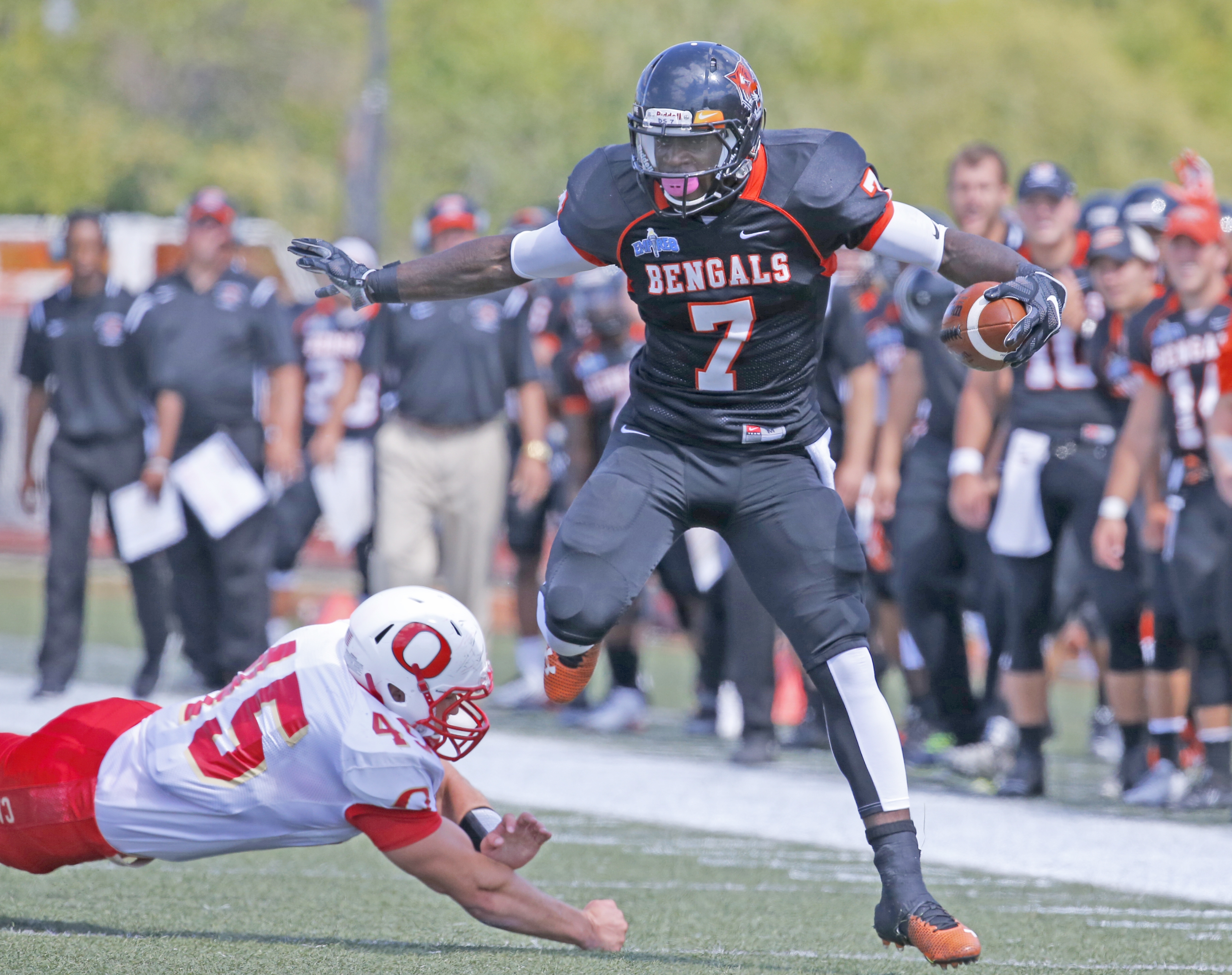 Dale Stewart, who ran for four touchdowns, carries the ball for Buffalo State in Saturday's season opener against Otterbein.