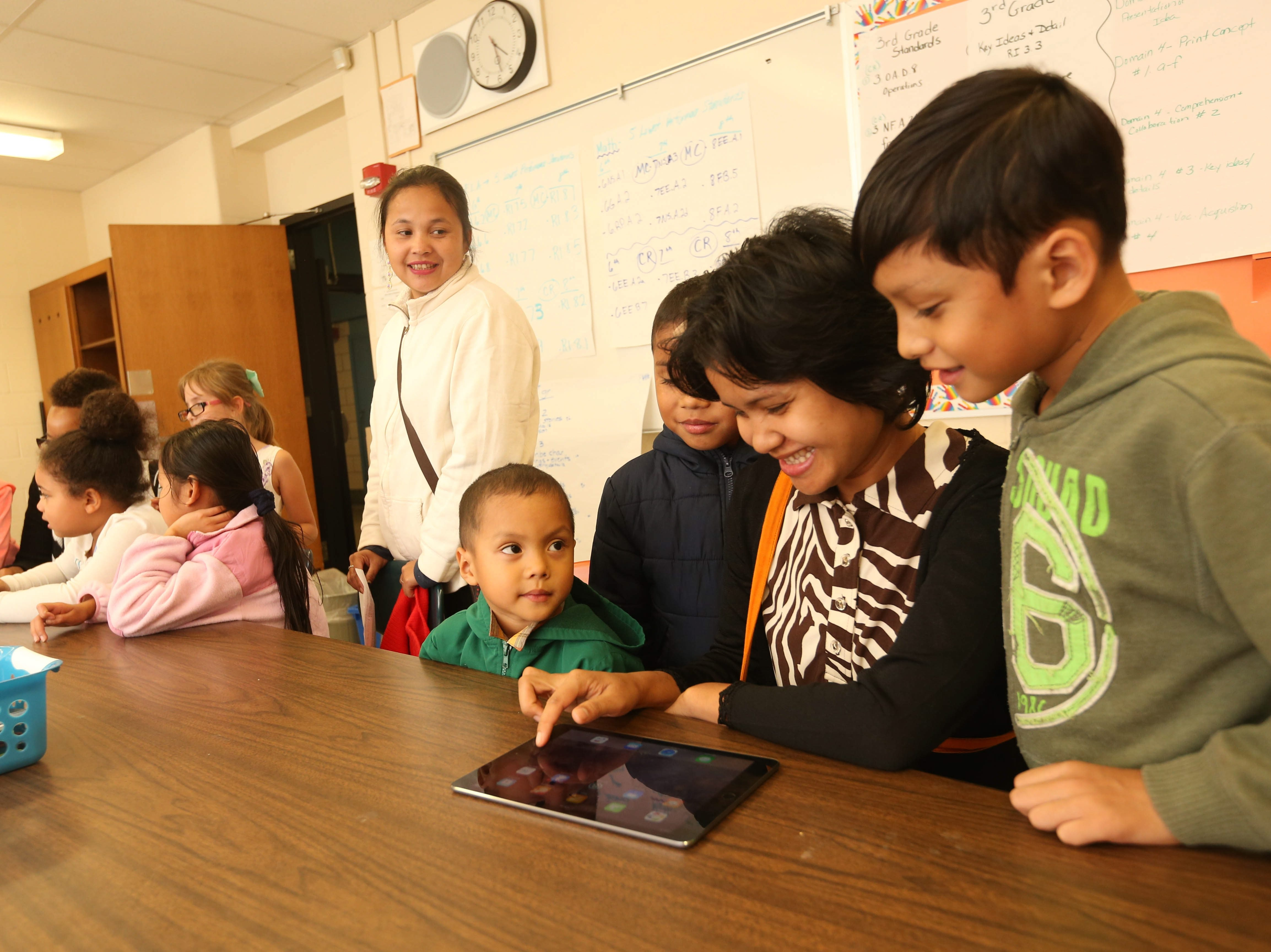 Students use iPads at West Hertel Academy. (Sharon Cantillon/Buffalo News)