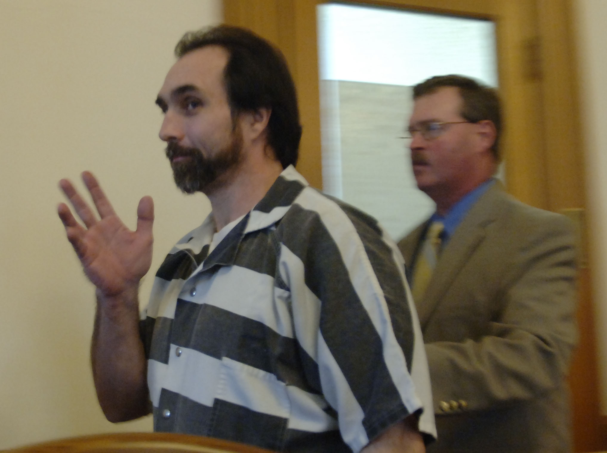 Ralph 'Bucky' Phillips waves after pleading guilty in Chautauqua County Court in Mayville on Nov. 29, 2006. Photo by Derek Gee