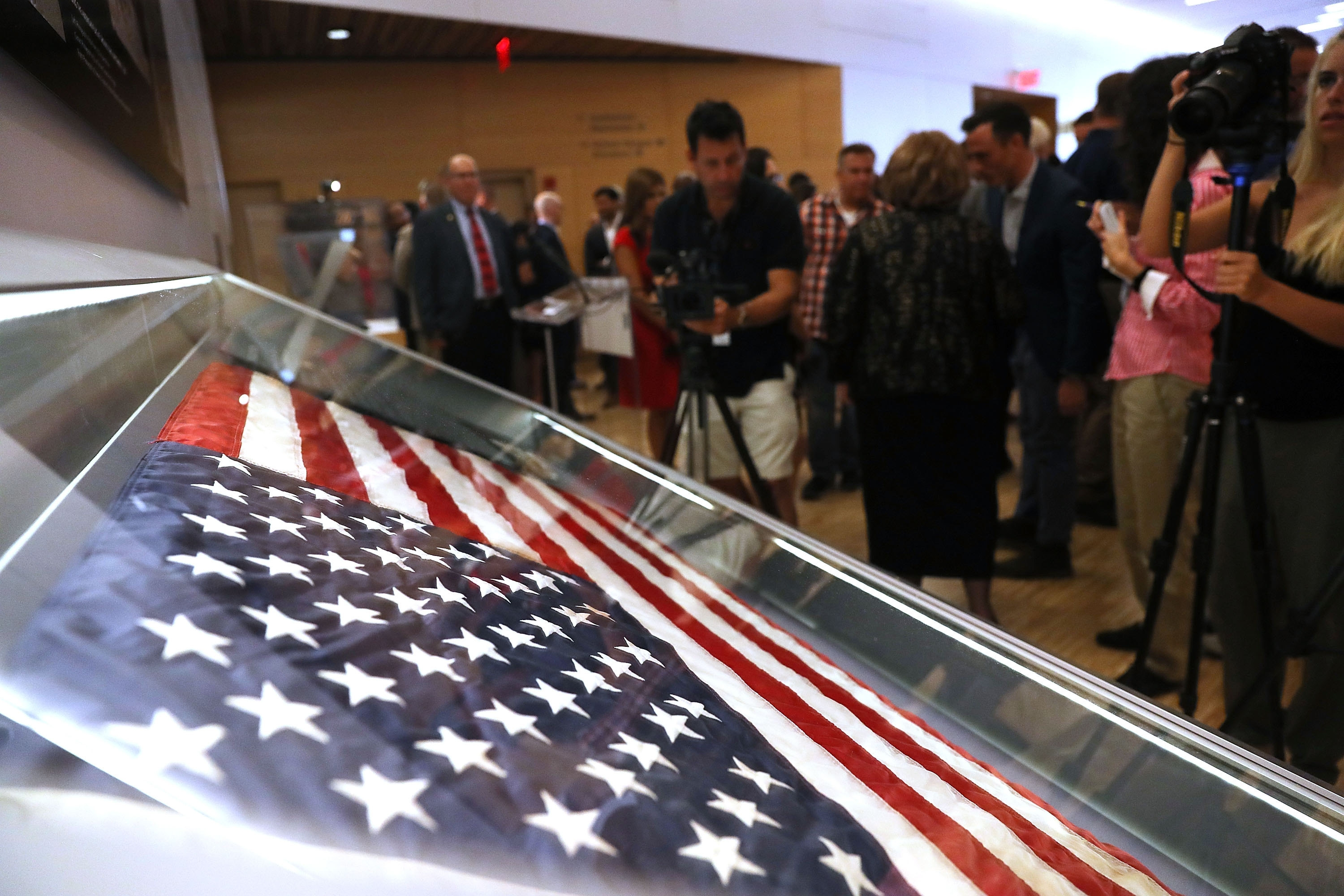 The American flag that was raised by firefighters at the World Trade Center is on display at the National September 11 Memorial & Museum. (Getty Images)