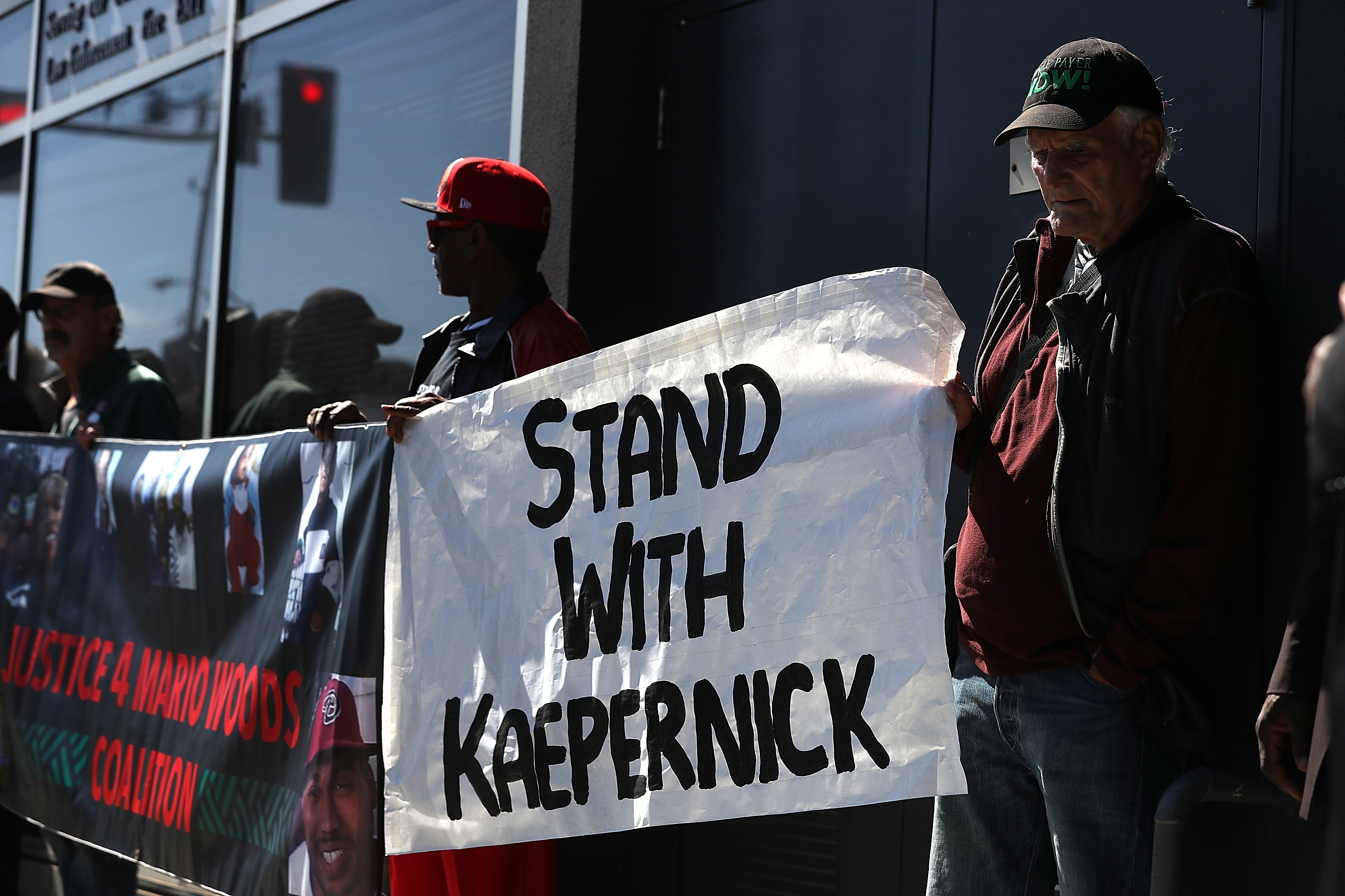 People demonstrate in support of San Francisco 49ers quarterback Colin Kaepernick outside the office of the San Francisco Police Officers Association.
