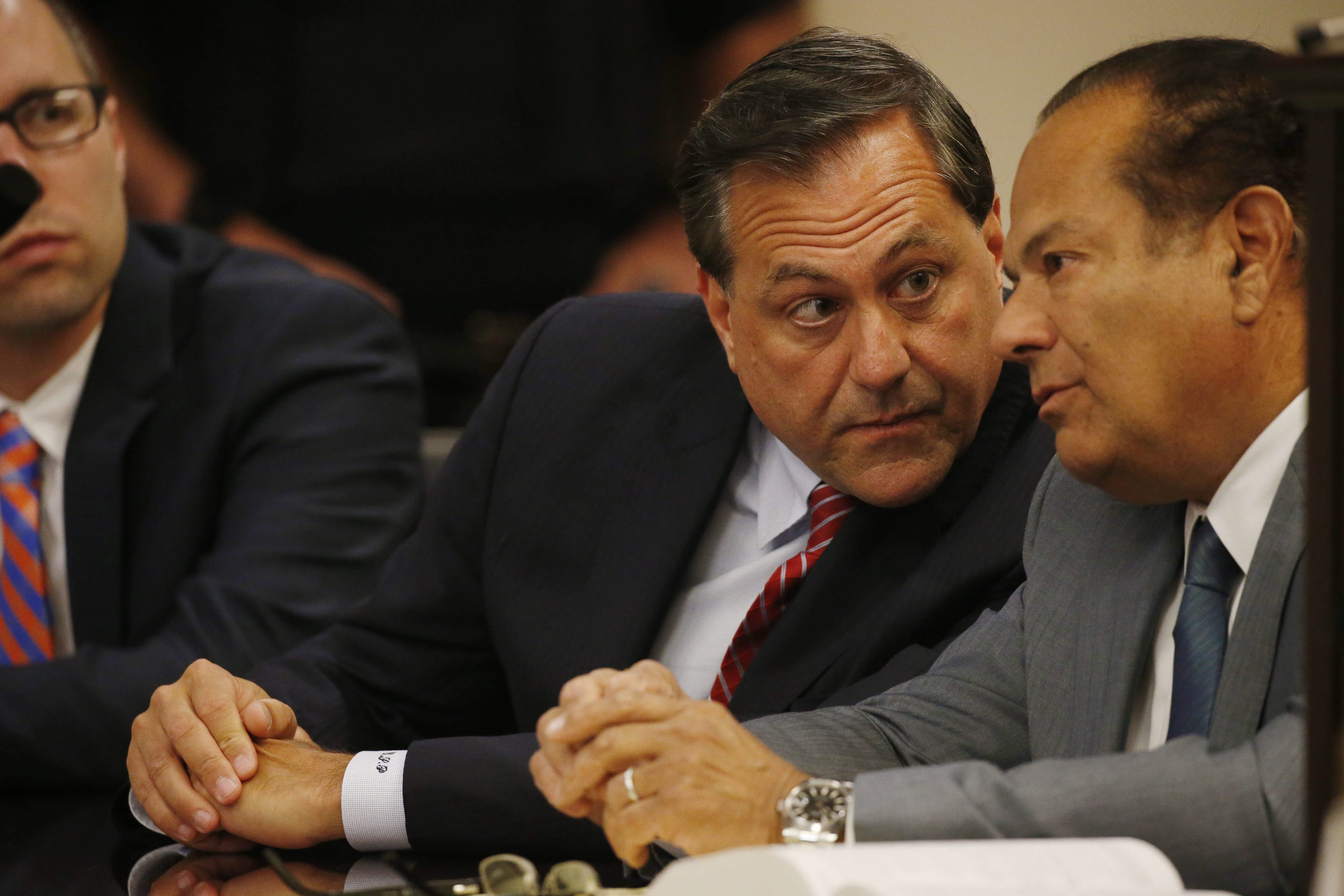 G. Steven Pigeon, center, confers with attorney Paul Cambria during his grand jury arraignment in State Supreme Court in June. (Derek Gee/Buffalo News)